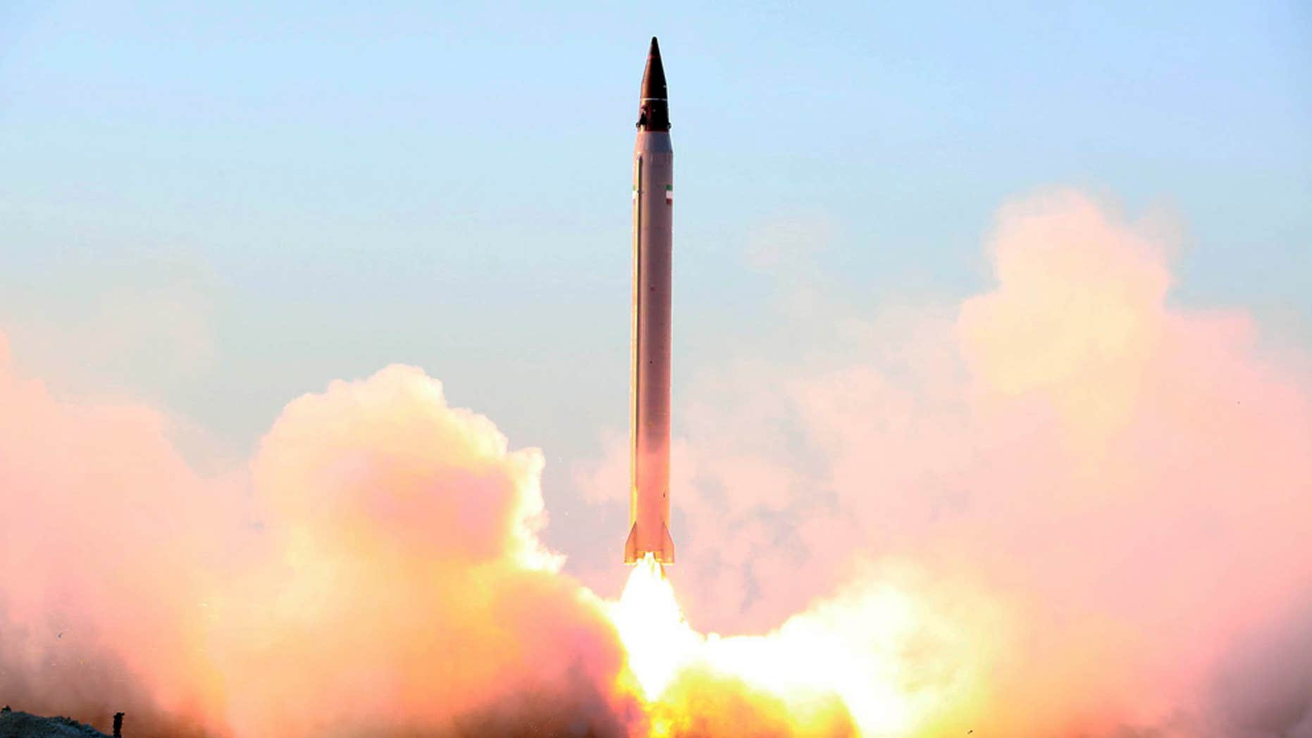 FILE - This file picture released by the official website of the Iranian Defense Ministry on Sunday, Oct. 11, 2015, claims to show the launching of an Emad long-range ballistic surface-to-surface missile in an undisclosed location.