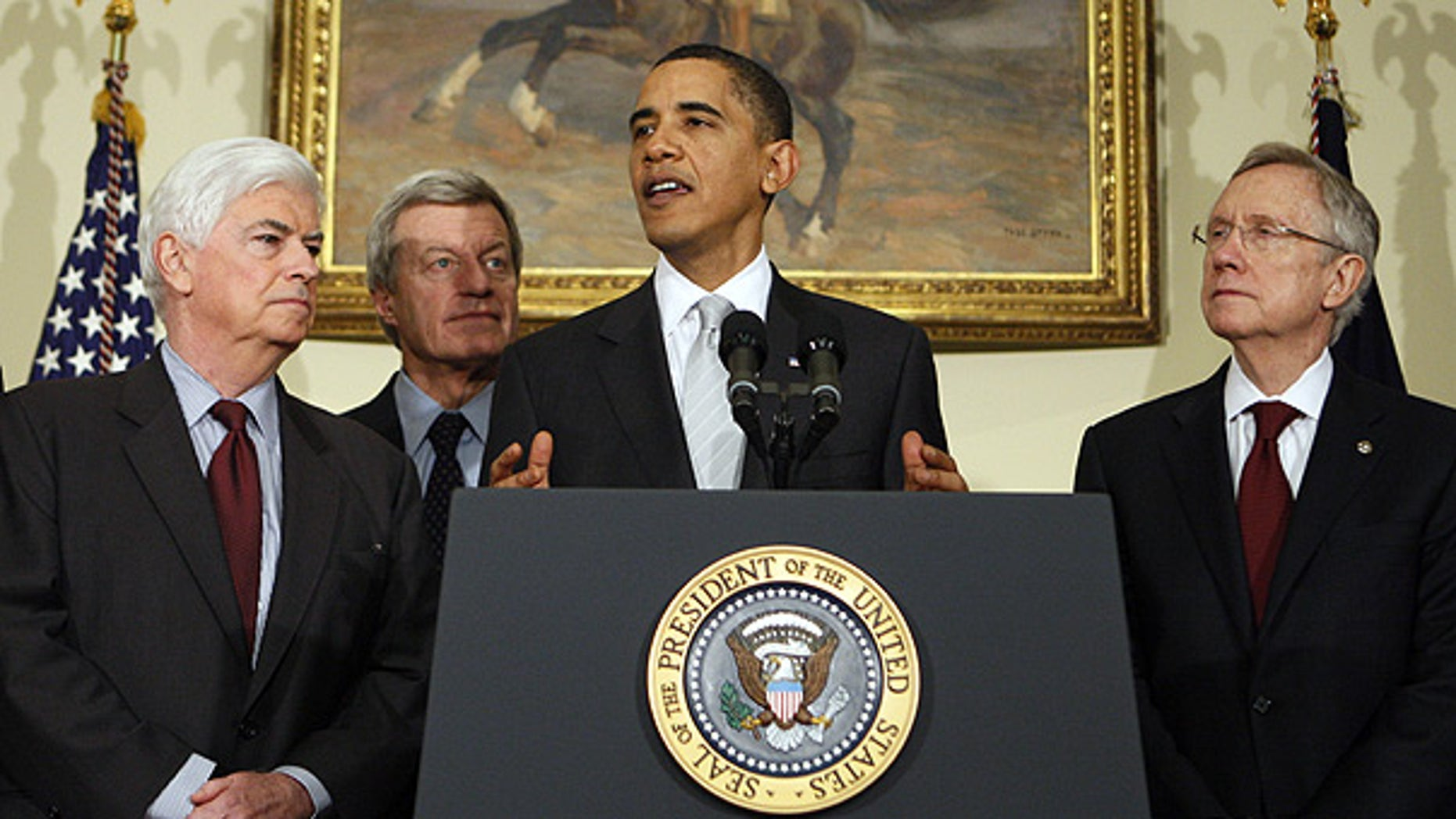 Dec. 15: President Obama, flanked by Senate Democrats, makes a statement on health care reform. (AP)