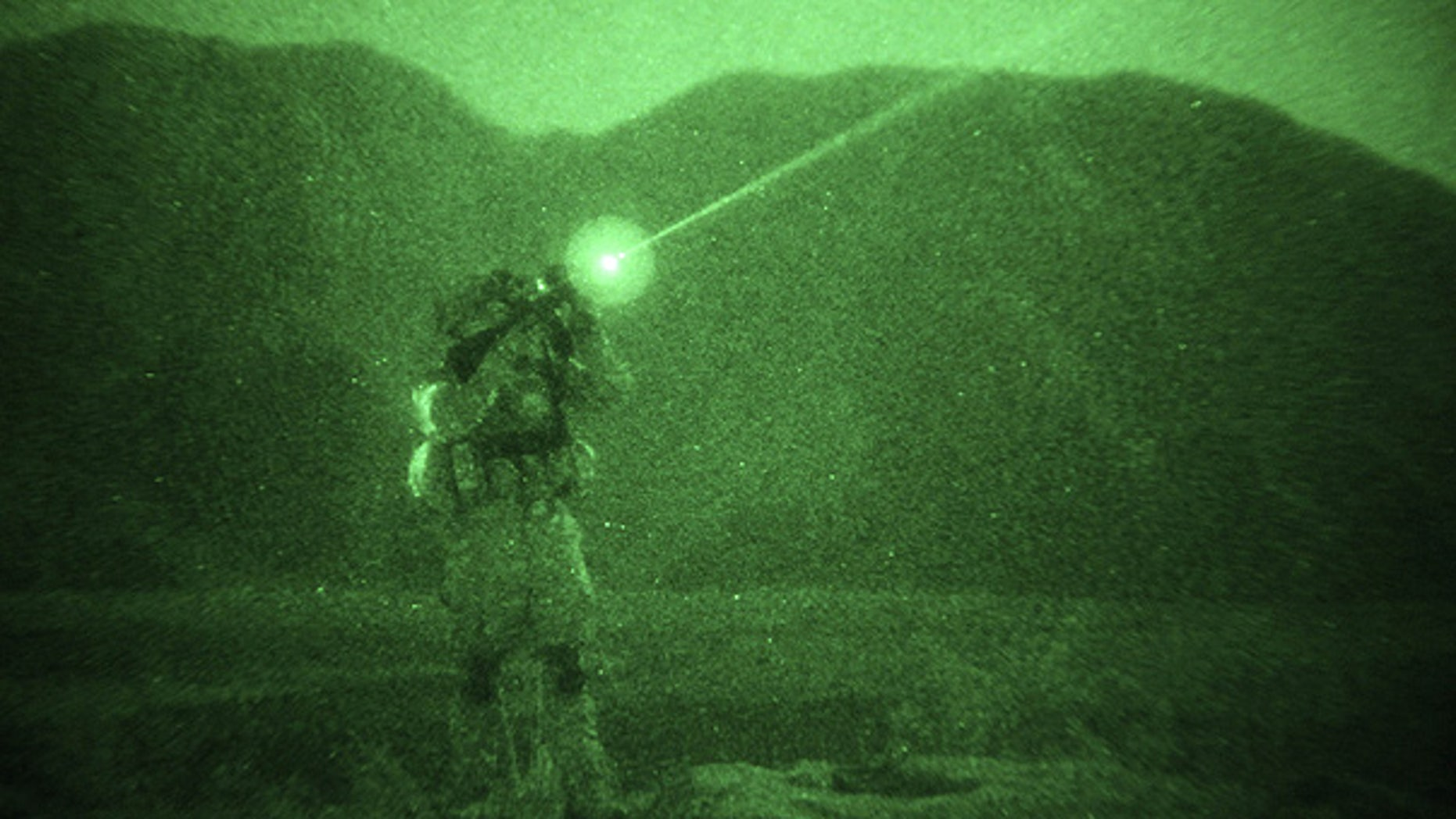 Dec. 15: In this photo taken with night vision, a U.S. soldier looks through his gun during a night patrol in eastern Afghanistan.