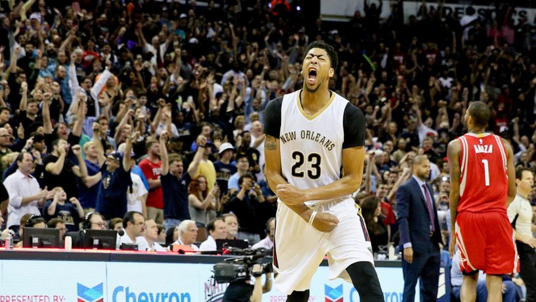 Dec 26, 2015; New Orleans, LA, USA; New Orleans Pelicans forward Anthony Davis (23) celebrates after defeating the Houston Rockets 110-108 at the Smoothie King Center. Mandatory Credit: Derick E. Hingle-USA TODAY Sports
