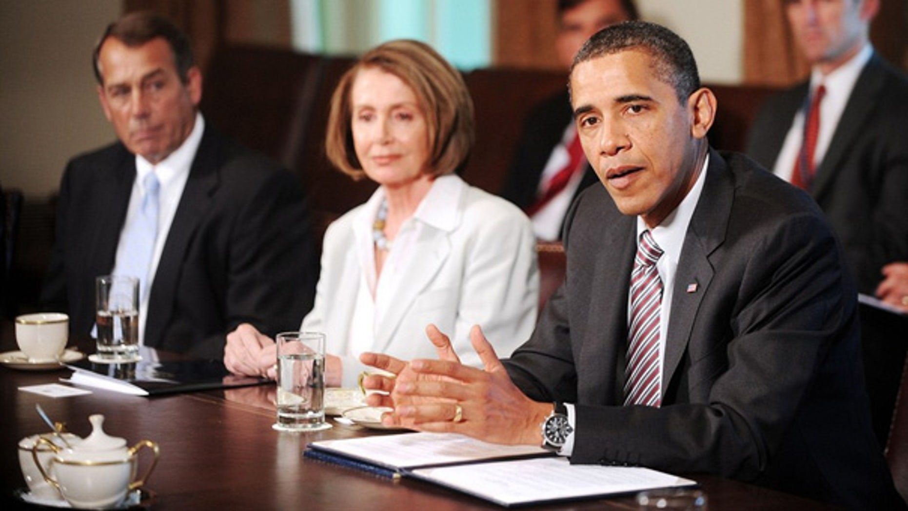 President Obama talks with House Speaker Nancy Pelosi and Republican House Minority Leader John Boehner in the White House earlier this year.
