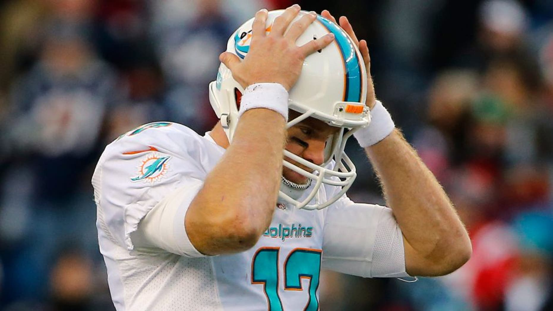 Dec 14, 2014; Foxborough, MA, USA; Miami Dolphins quarterback Ryan Tannehill (17) reacts to a missed pass during the second half against the New England Patriots at Gillette Stadium. The Patriots won 41-13. Mandatory Credit: Winslow Townson-USA TODAY Sports