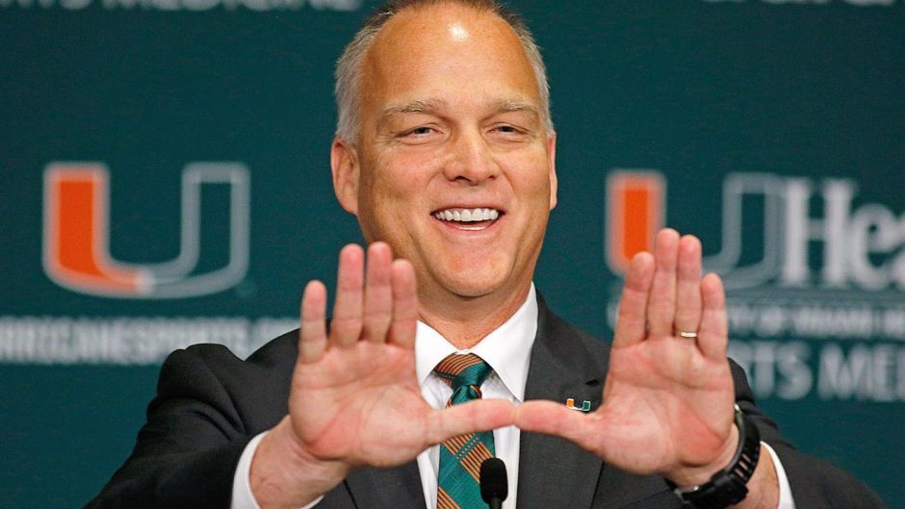 CORAL GABLES, FL - DECEMBER 04: New University of Miami Hurricanes head coach Mark Richt makes the 'U' sign after he was introduced at a press conference at the school on December 4, 2015 in Coral Gables, Florida. (Photo by Joe Skipper/Getty Images)