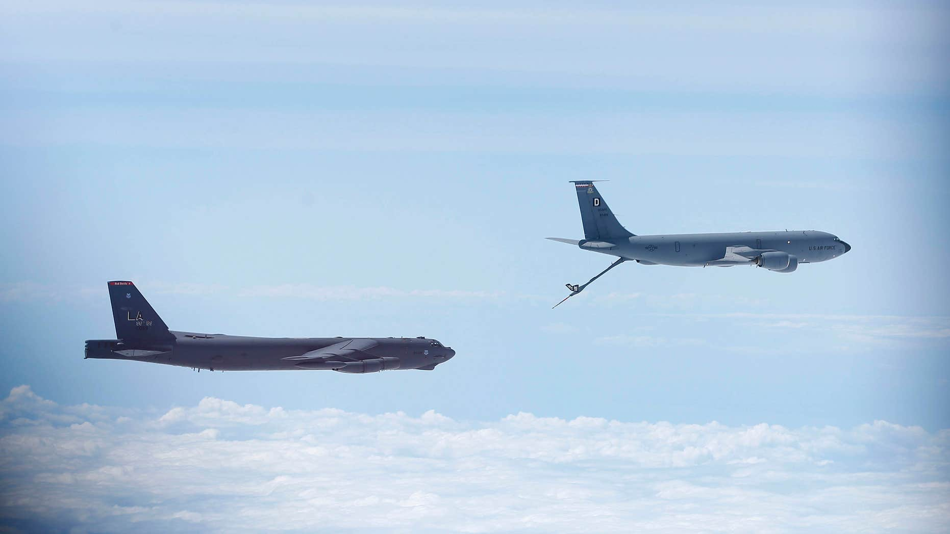 June 17, 2014: A U.S. Air Force B-52 is seen through the window of another as it prepares for a mid-air refuel during a training mission in the United Kingdom's airspace.