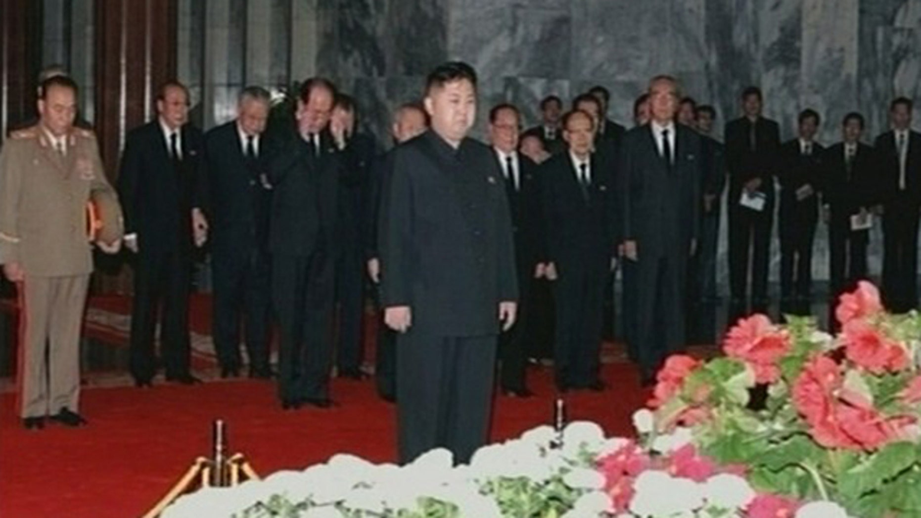 December 20, 2011: New North Korean ruler Kim Jong-un pays his respects to his father and former leader Kim Jong-il lying in state at the Kumsusan Memorial Palace in Pyongyang.
