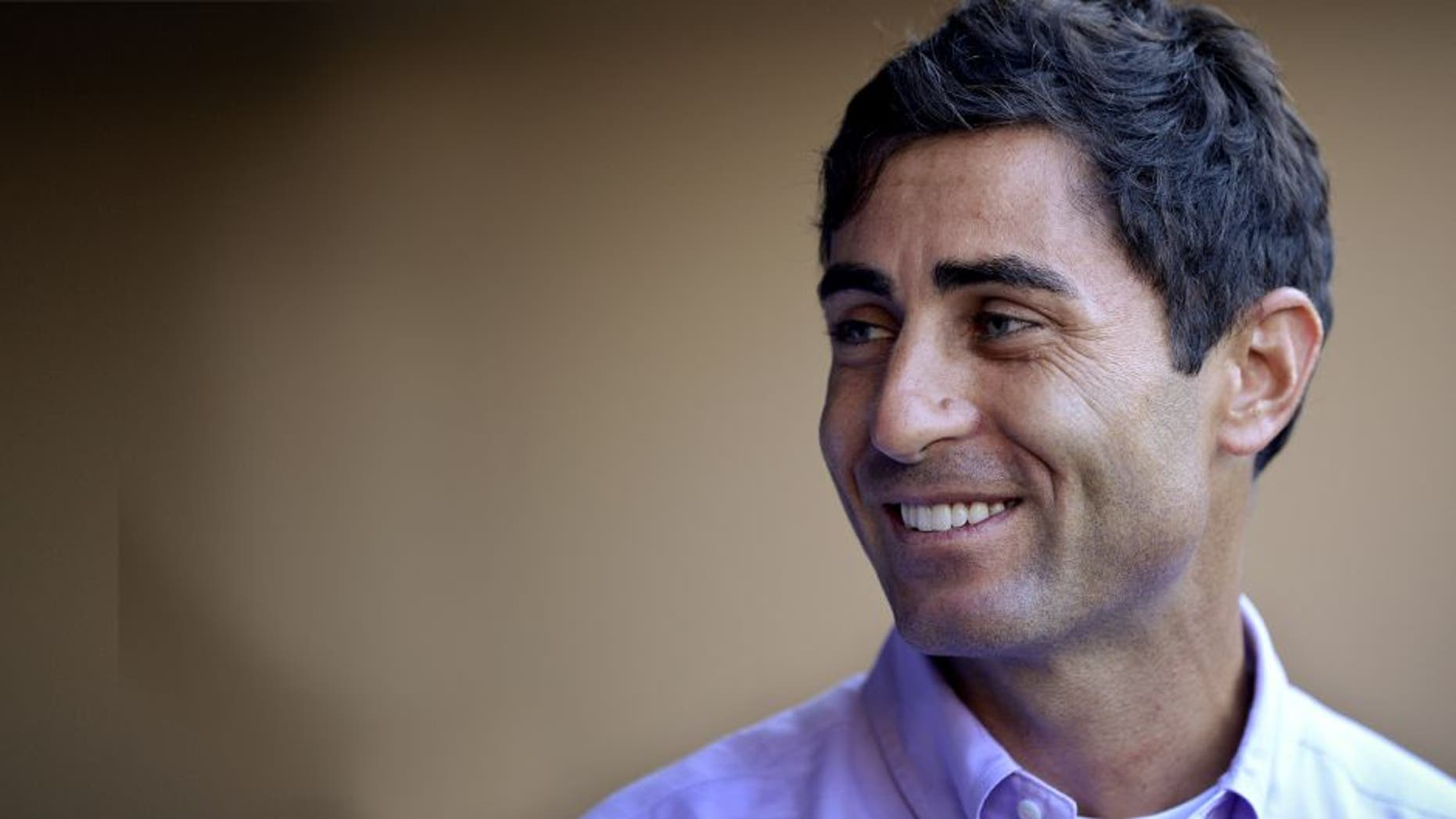 SAN DIEGO, CA - AUGUST 26: AJ Preller of the San Diego Padres visits the dugout prior to the game against the Milwaukee Brewers at Petco Park on August 26, 2014 in San Diego, California. (Photo by Andy Hayt/San Diego Padres/Getty Images)