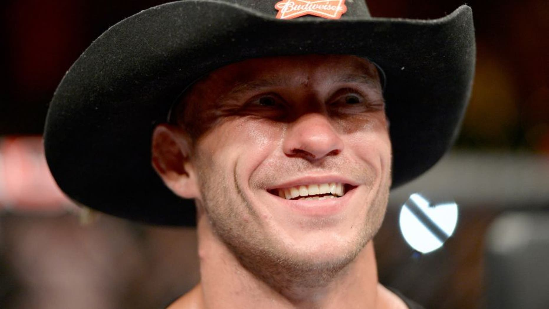 "ATLANTIC CITY, NJ - JULY 16: Donald ""Cowboy"" Cerrone celebrates after defeating Jim Miller in their lightweight bout during the UFC Fight Night event at Revel Casino on July 16, 2014 in Atlantic City, New Jersey. (Photo by Jeff Bottari/Zuffa LLC/Zuffa LLC via Getty Images) *** Local Caption ***Donald Cerrone"