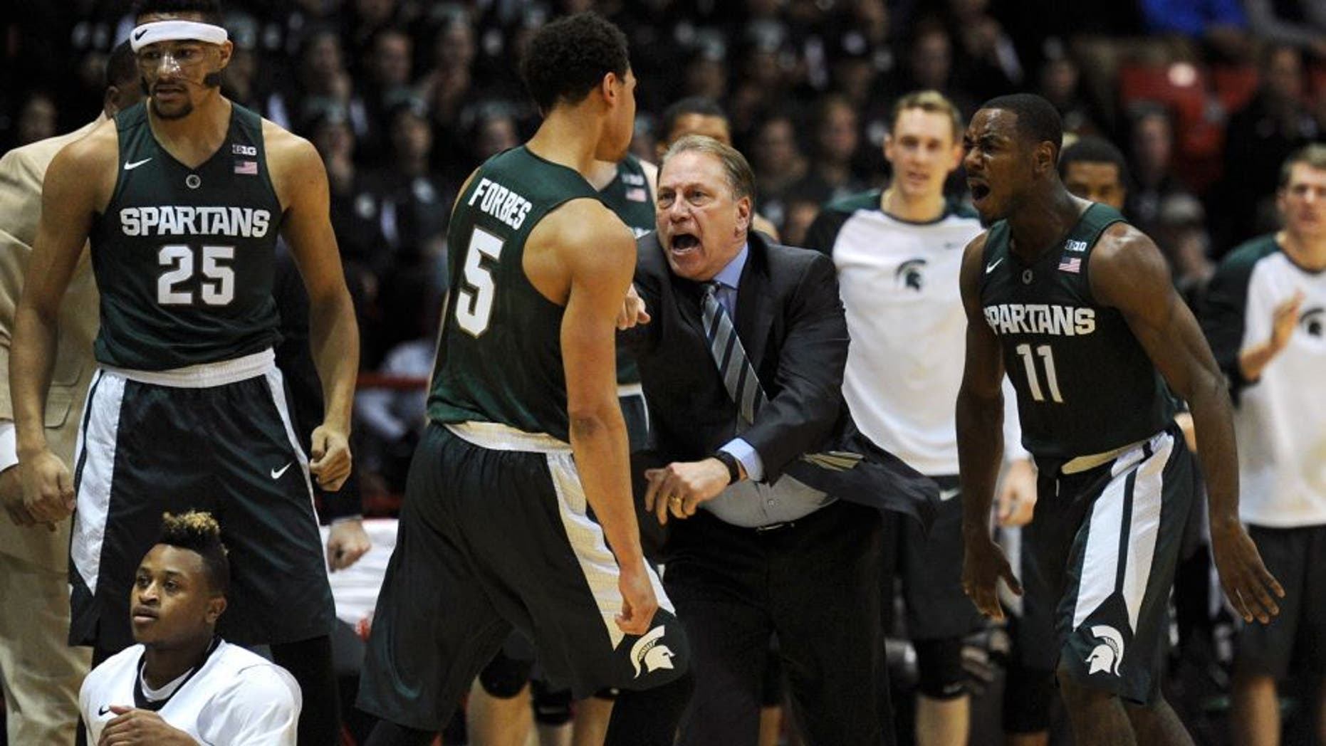 Dec 19, 2015; Boston, MA, USA; Michigan State Spartans head coach Tom Izzo reacts after a play made by guard Bryn Forbes (5) during the first half against the Northeastern Huskies at Matthews Arena. Mandatory Credit: Bob DeChiara-USA TODAY Sports