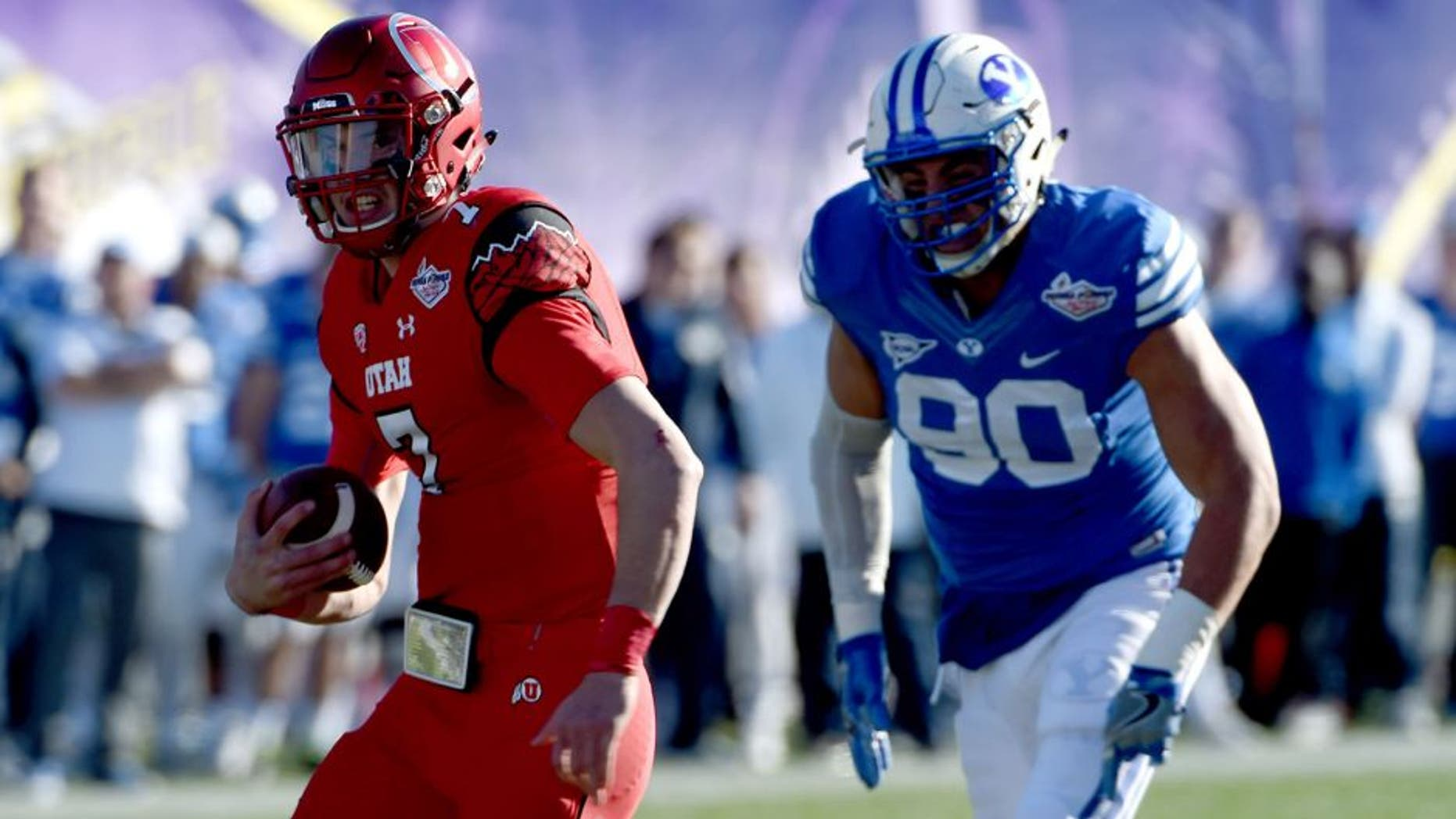 Dec 19, 2015; Las Vegas, NV, USA; Utah Utes quarterback Travis Wilson (7) rushes up the middle as the Utes face off against BYU in the Las Vegas Bowl at Sam Boyd Stadium. Mandatory Credit: Stephen R. Sylvanie-USA TODAY Sports
