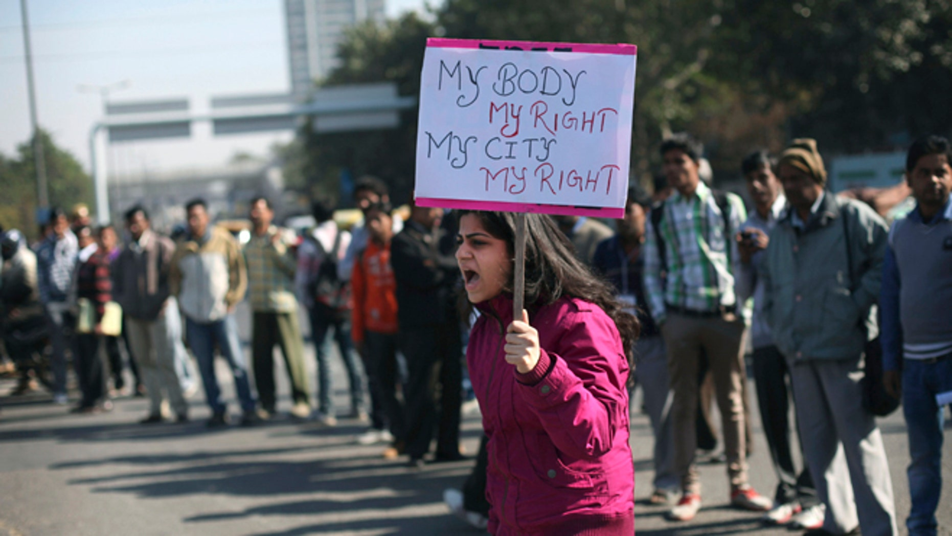 Dec. 19, 2012: An Indian woman shouts slogans outside the Delhi Police headquarters during a protest in New Delhi, India.