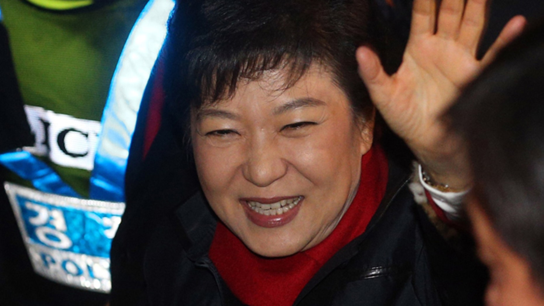 Dec. 19, 2012: South Korea's presidential candidate Park Geun-hye of the ruling Saenuri Party waves to supporters as she heads to her office from her house in Seoul, South Korea.