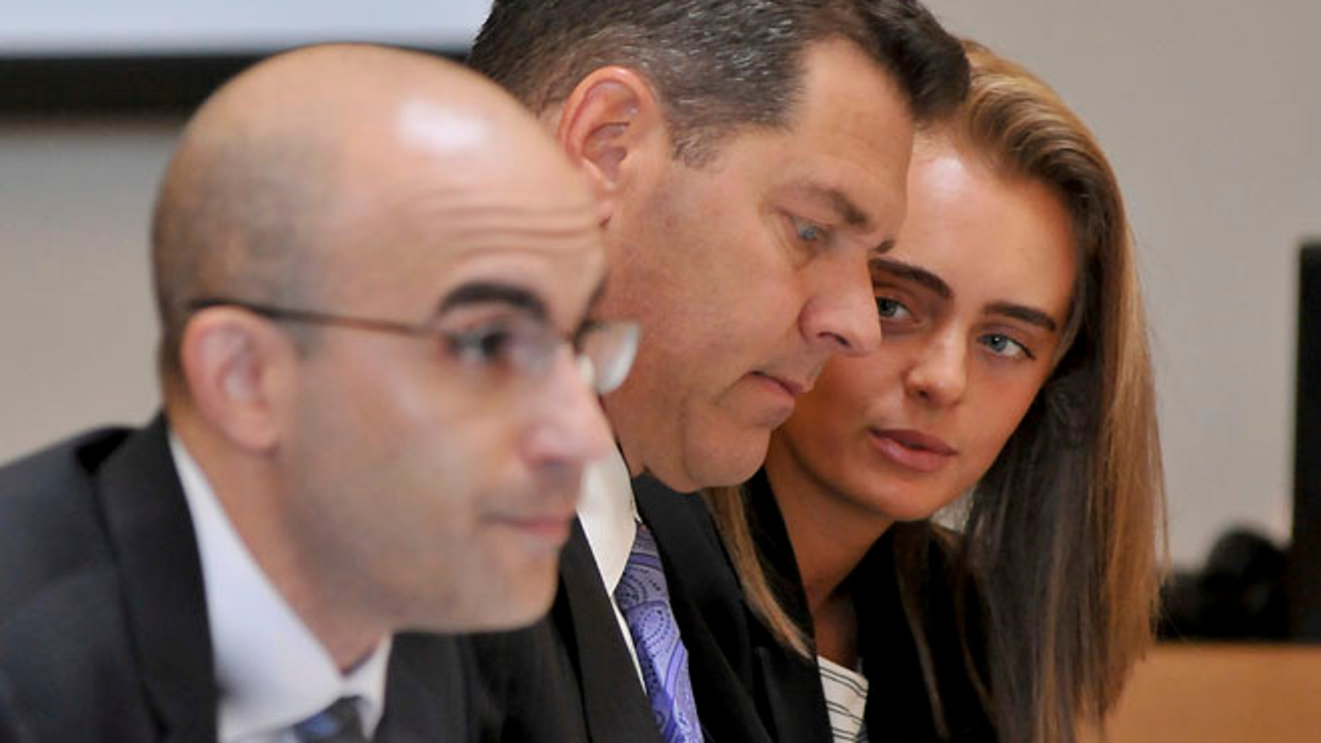 June 16: Defendant Michelle Carter, right, confers with her lawyer Joe Cataldo, center, as second defense attorney Cory Madera listens to testimonies.