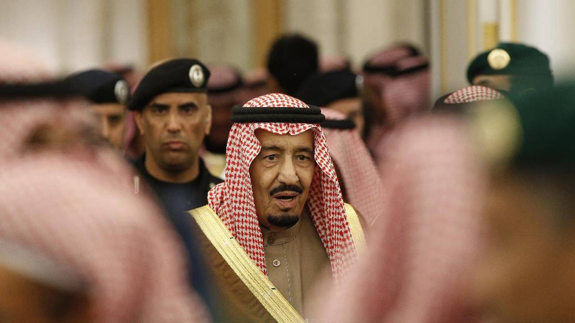 FILE - In this Jan. 24, 2015 file photo, Saudi Arabia's King Salman attends a ceremony at the Diwan royal palace in Riyadh. Saudi Arabia's King Salman is reducing the salaries and benefits of senior government officials as lower oil prices continue to pinch the kingdom's economy, but a separate decision also cuts bonuses for public sector employees. (AP Photo/Yoan Valat, Pool, File)