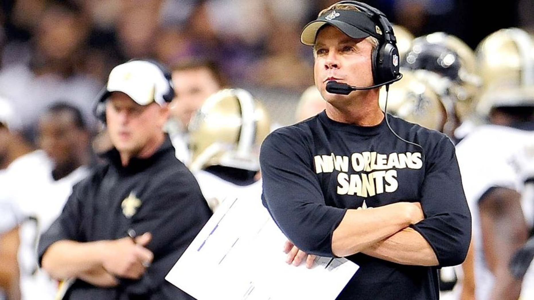 NEW ORLEANS, LA - AUGUST 09: Sean Payton, head coach of the New Orleans Saints, watches action during a game against the Kansas City Chiefs at the Mercedes-Benz Superdome on August 9, 2013 in New Orleans, Louisiana. The Saints won 17-13. (Photo by Stacy Revere/Getty Images)