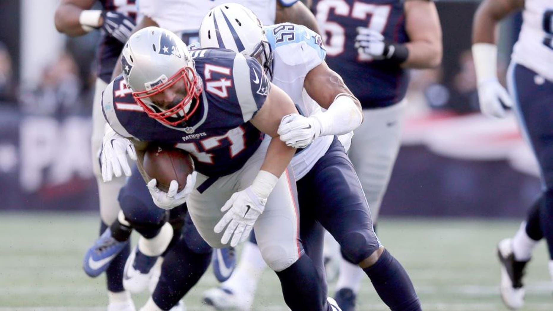 Tennessee Titans linebacker Wesley Woodyard (59) tackles New England Patriots running back Joey Iosefa (47) in the first half of an NFL football game, Sunday, Dec. 20, 2015, in Foxborough, Mass. (AP Photo/Charles Krupa)