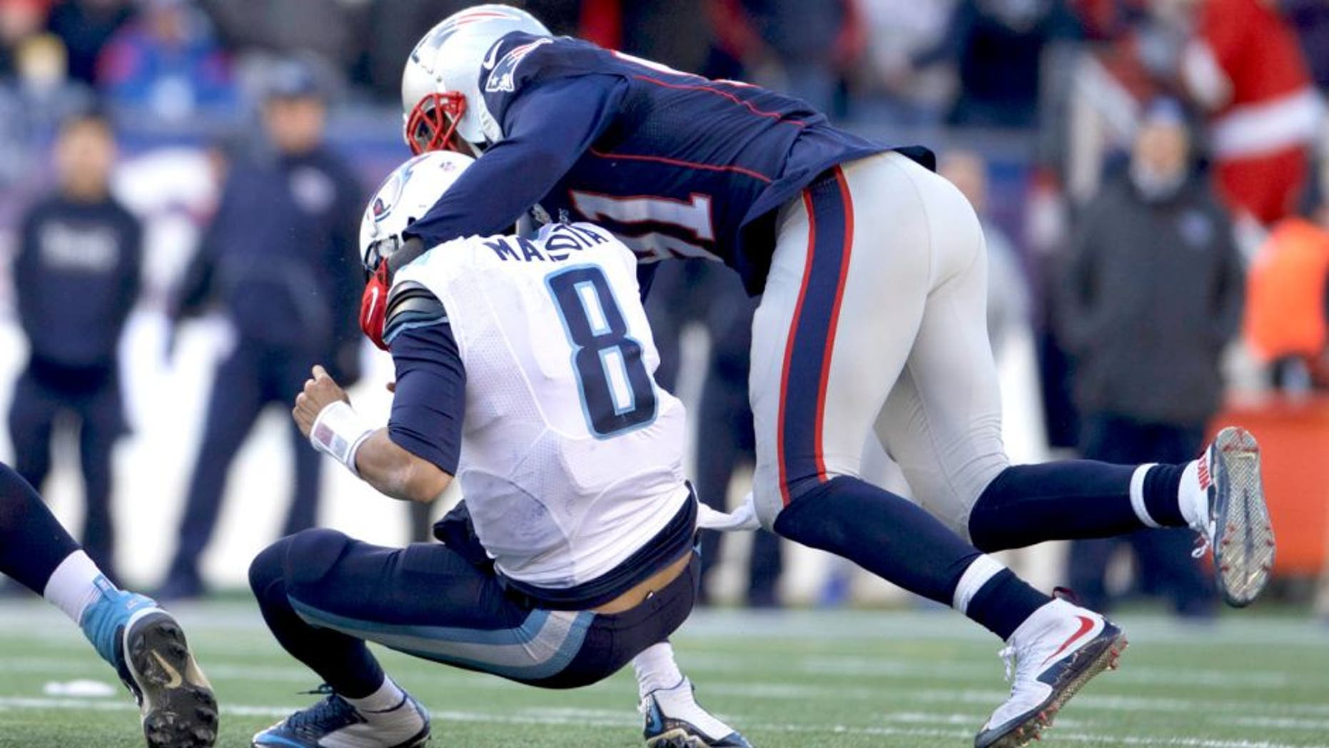 Dec 20, 2015; Foxborough, MA, USA; New England Patriots outside linebacker Jamie Collins (91) sacks Tennessee Titans quarterback Marcus Mariota (8) in the first half at Gillette Stadium. The Patriots defeated the Titans 33-16. Mandatory Credit: David Butler II-USA TODAY Sports