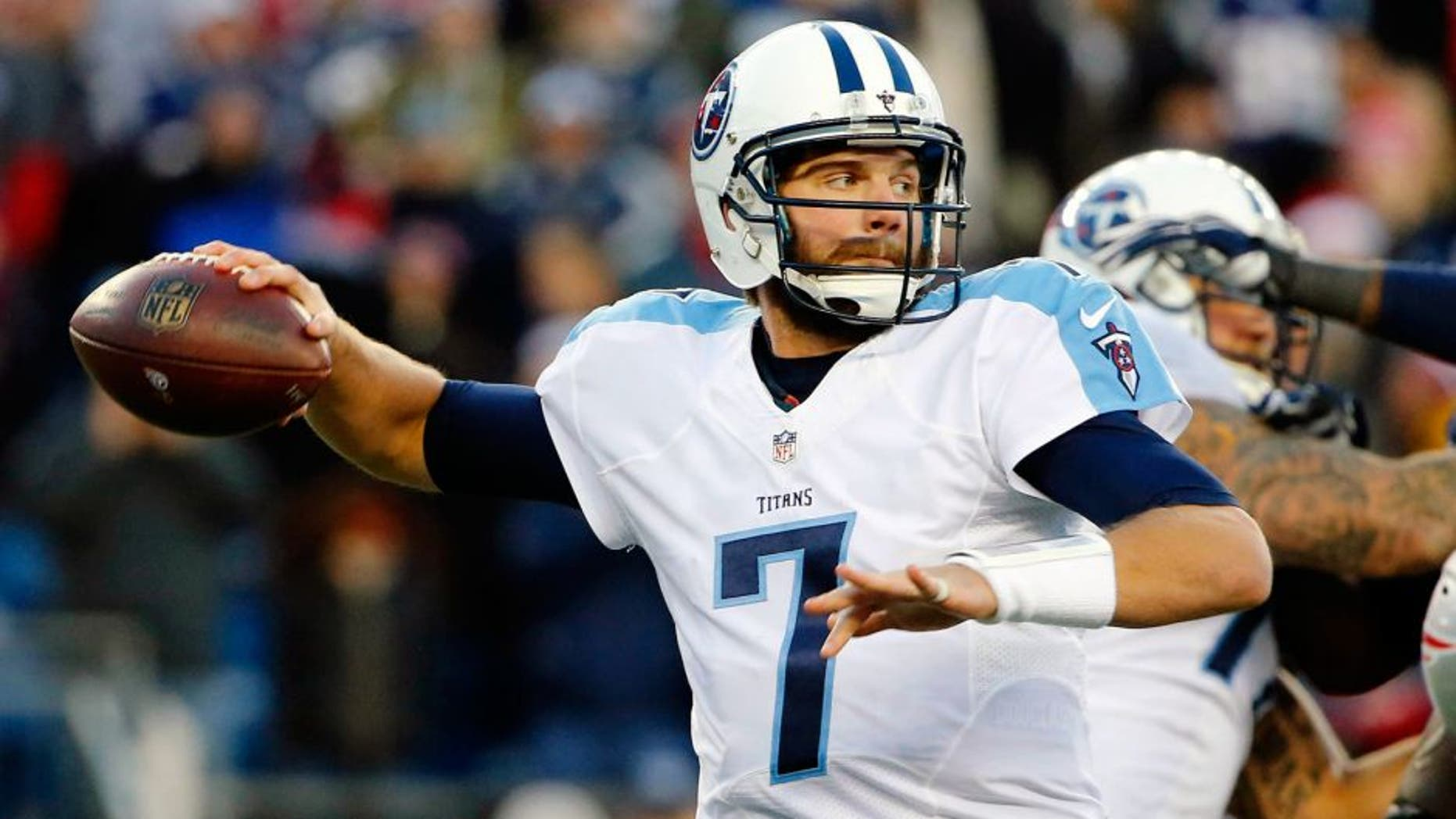 Dec 20, 2015; Foxborough, MA, USA; Tennessee Titans quarterback Zach Mettenberger (7) throws under pressure during the second half of the New England Patriots 33-16 win over the Tennessee Titans at Gillette Stadium. Mandatory Credit: Winslow Townson-USA TODAY Sports