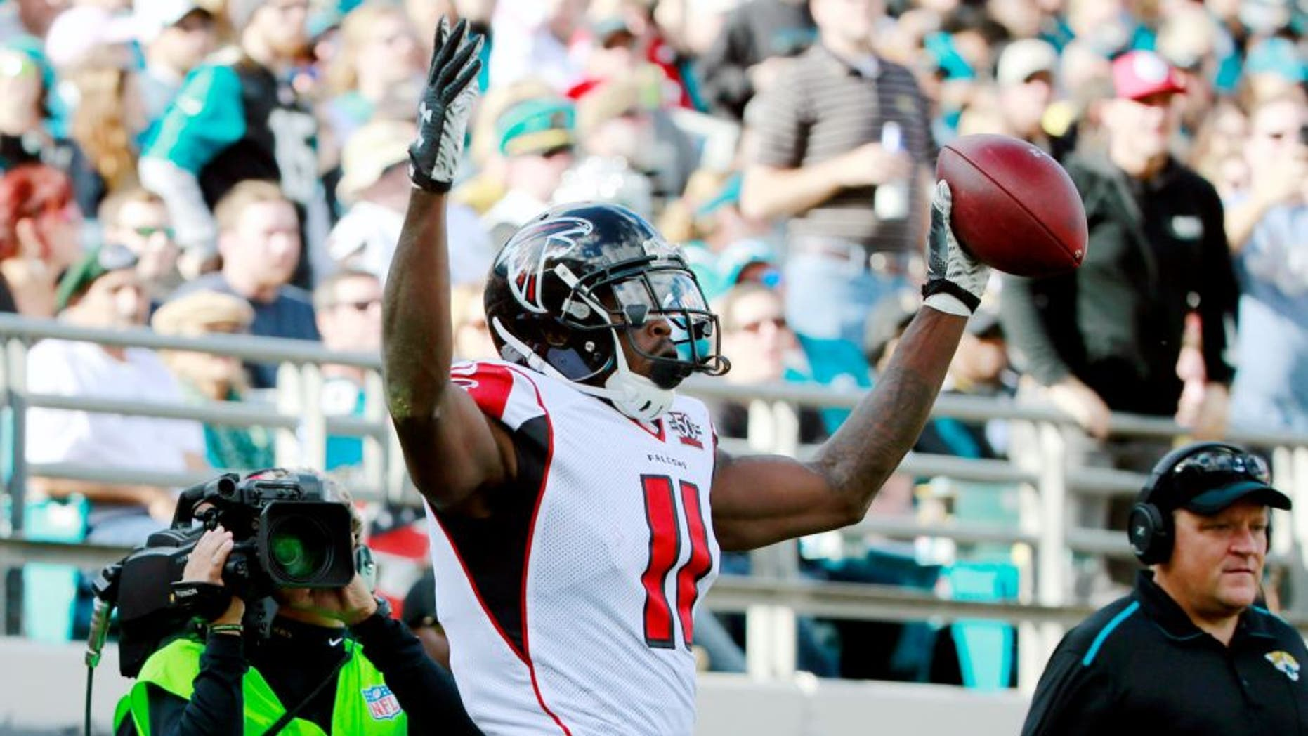 Dec 20, 2015; Jacksonville, FL, USA; Atlanta Falcons wide receiver Julio Jones (11) reacts after scoring a touchdown against the Jacksonville Jaguars during the first half at EverBank Field. Mandatory Credit: Kim Klement-USA TODAY Sports