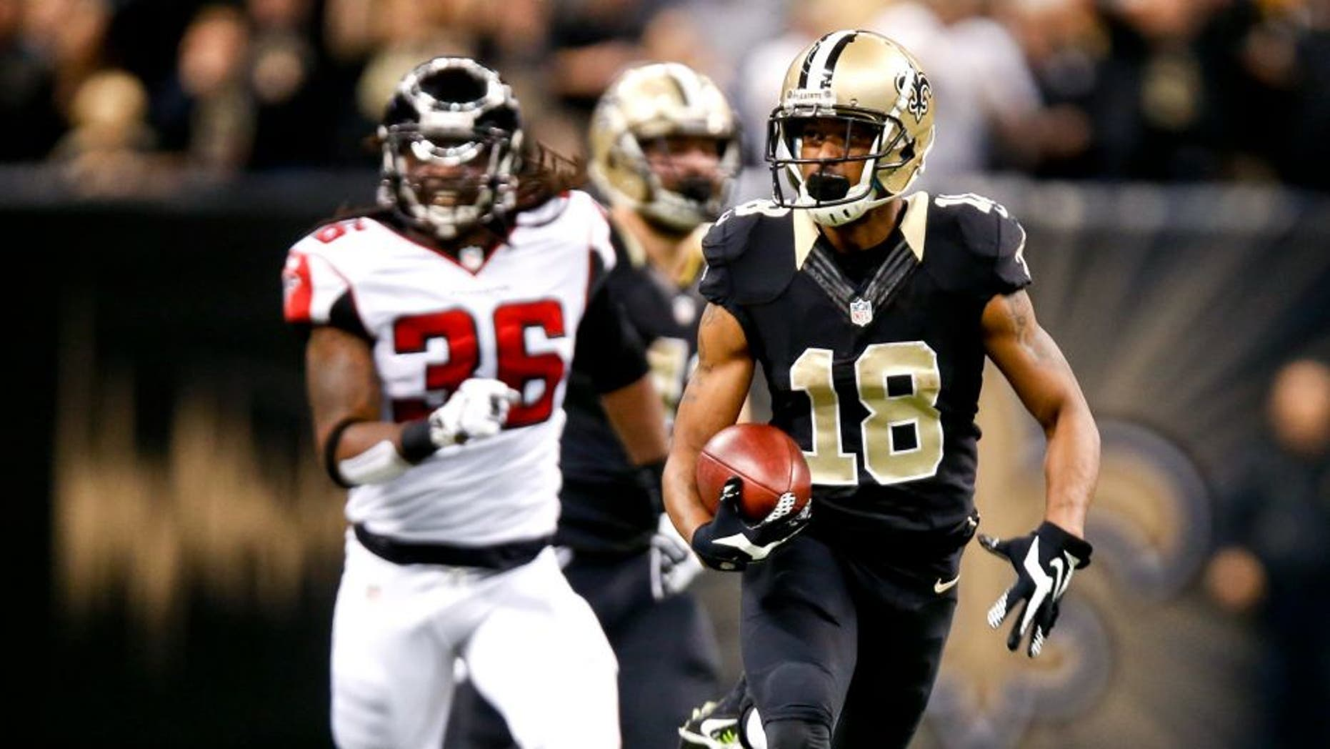 Dec 21, 2014; New Orleans, LA, USA; New Orleans Saints wide receiver Jalen Saunders (18) returns the opening kickoff as Atlanta Falcons strong safety Kemal Ishmael (36) chases during the first quarter at the Mercedes-Benz Superdome. Mandatory Credit: Derick E. Hingle-USA TODAY Sports