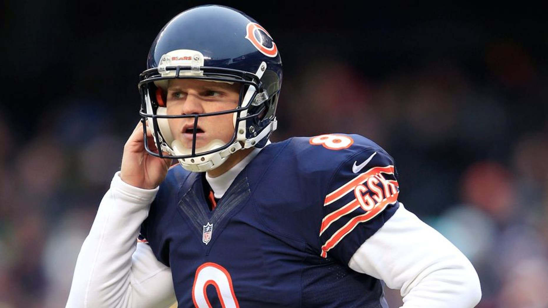 CHICAGO, IL - DECEMBER 21: Jimmy Clausen #8 of the Chicago Bears heads off the field after failing to convert on a third down during the first quarter of their game against the against the Detroit Lions at Soldier Field on December 21, 2014 in Chicago, Illinois. (Photo by Jamie Squire/Getty Images)
