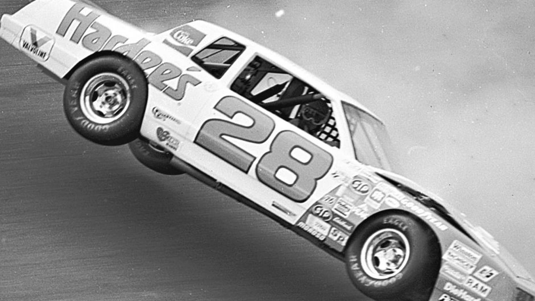 DAYTONA BEACH, FL — February 14, 1983: Cale Yarborough gazes out the passenger side window of the Hardee's Chevrolet wondering what will happen next as the car lifts in the air before rolling over during qualifying for the Daytona 500 NASCAR Cup race at Daytona International Speedway. This incident took place on Yarborough's second qualifying lap after he turned his first circuit at 200.503 mph, the first car to break the 200 mph barrier in qualifying for a Cup race at Daytona. Because he had to go to a back-up car for the race, Yarborough's first lap time was disallowed but he came back to win the Daytona 500 in his back-up machine. (Photo by ISC Images & Archives via Getty Images)