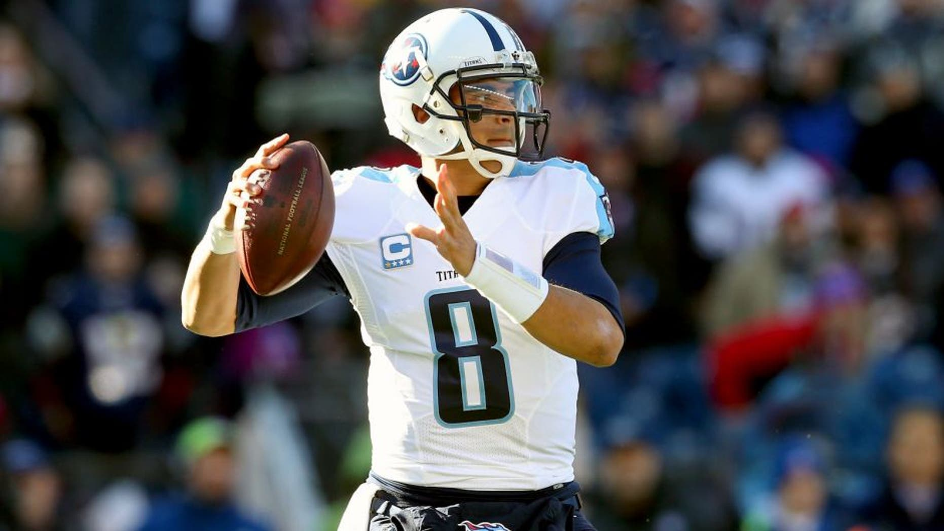 FOXBORO, MA - DECEMBER 20: Marcus Mariota #8 of the Tennessee Titans looks to pass during the first half against the New England Patriots at Gillette Stadium on December 20, 2015 in Foxboro, Massachusetts. (Photo by Jim Rogash/Getty Images)