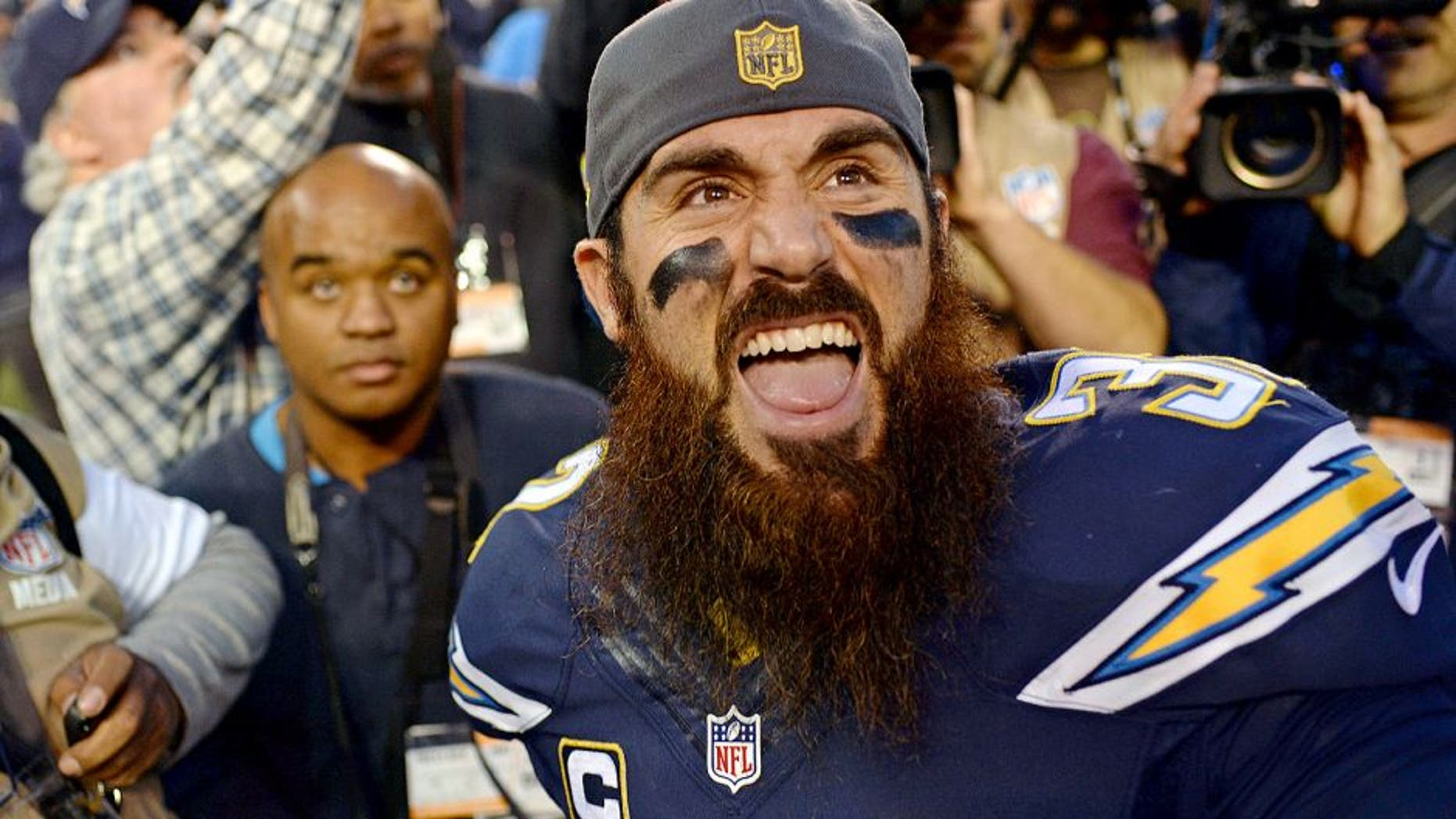 Dec 20, 2015; San Diego, CA, USA; San Diego Chargers free safety Eric Weddle (32) reacts to fans after the Chargers beat the Miami Dolphins 30-14 at Qualcomm Stadium. Mandatory Credit: Jake Roth-USA TODAY Sports