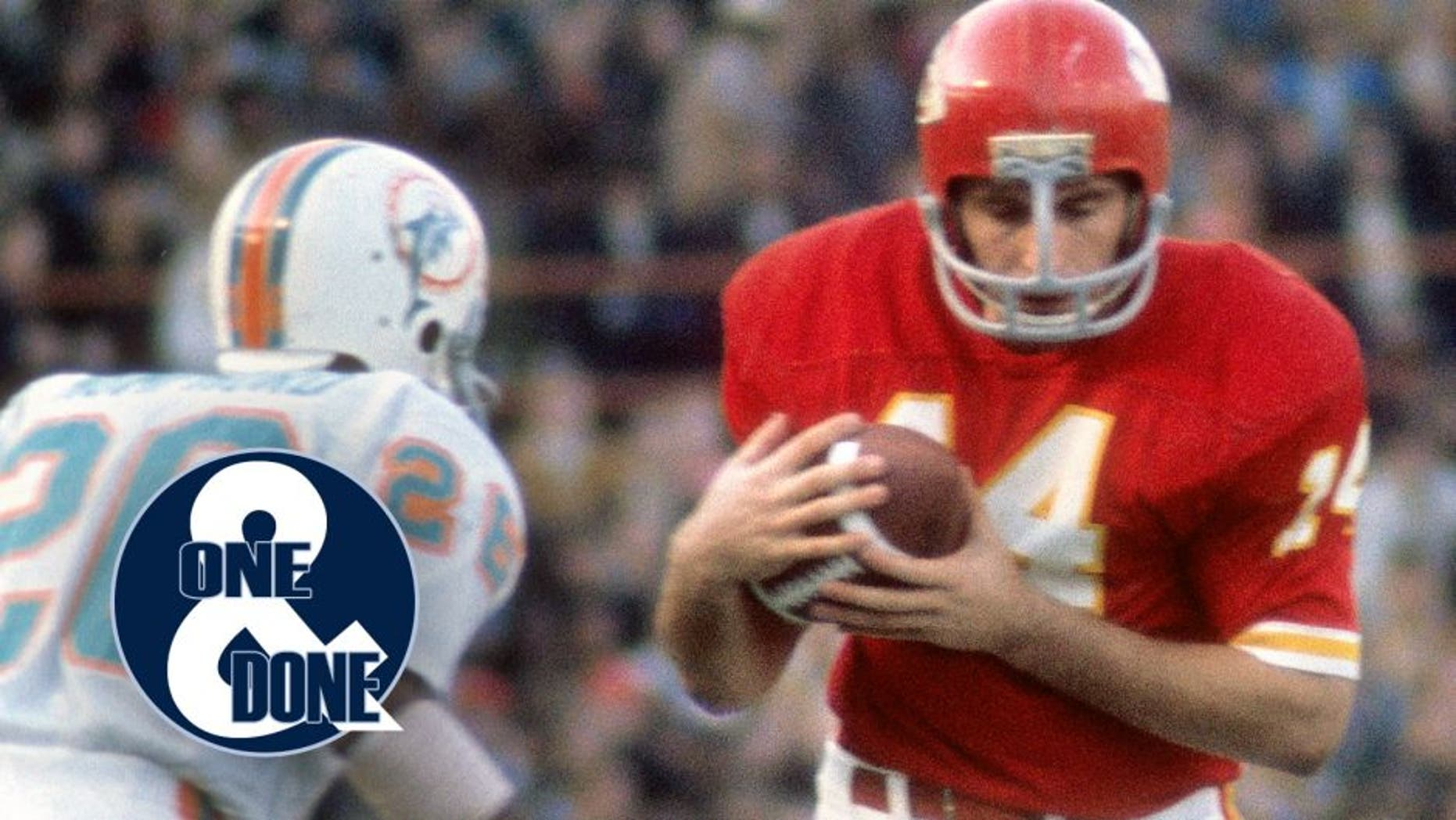 KANSAS CITY, MO - CIRCA 1972: Running Back Ed Podolak #14 of the Kansas City Chiefs running with the ball looks to get pass defensive back Lloyd Mumphord #26 of the Miami Dolphins during an NFL football game at Arrowhead Stadium in Kansas City, Missouri. Podolak played for the Chiefs from 1969-77. (Photo by Focus on Sport/Getty Images)