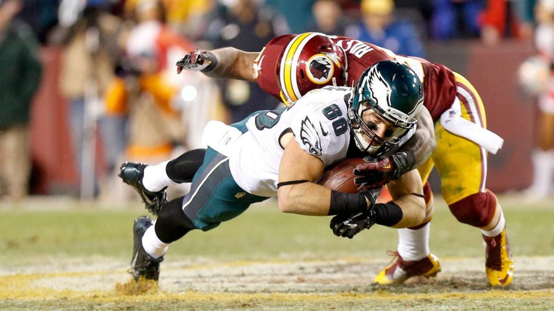 Dec 20, 2014; Landover, MD, USA; Philadelphia Eagles tight end Zach Ertz (86) catches the ball as Washington Redskins inside linebacker Perry Riley (56) tackles the fourth quarter at FedEx Field. The Redskins won 27-24. Mandatory Credit: Geoff Burke-USA TODAY Sports