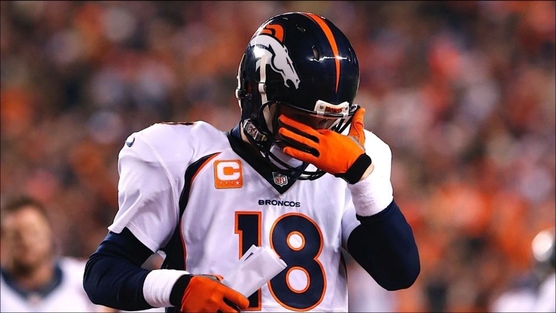 Dec 22, 2014; Cincinnati, OH, USA; Denver Broncos quarterback Peyton Manning (18) walks off the field at halftime against the Cincinnati Bengals at Paul Brown Stadium. Mandatory Credit: Aaron Doster-USA TODAY Sports