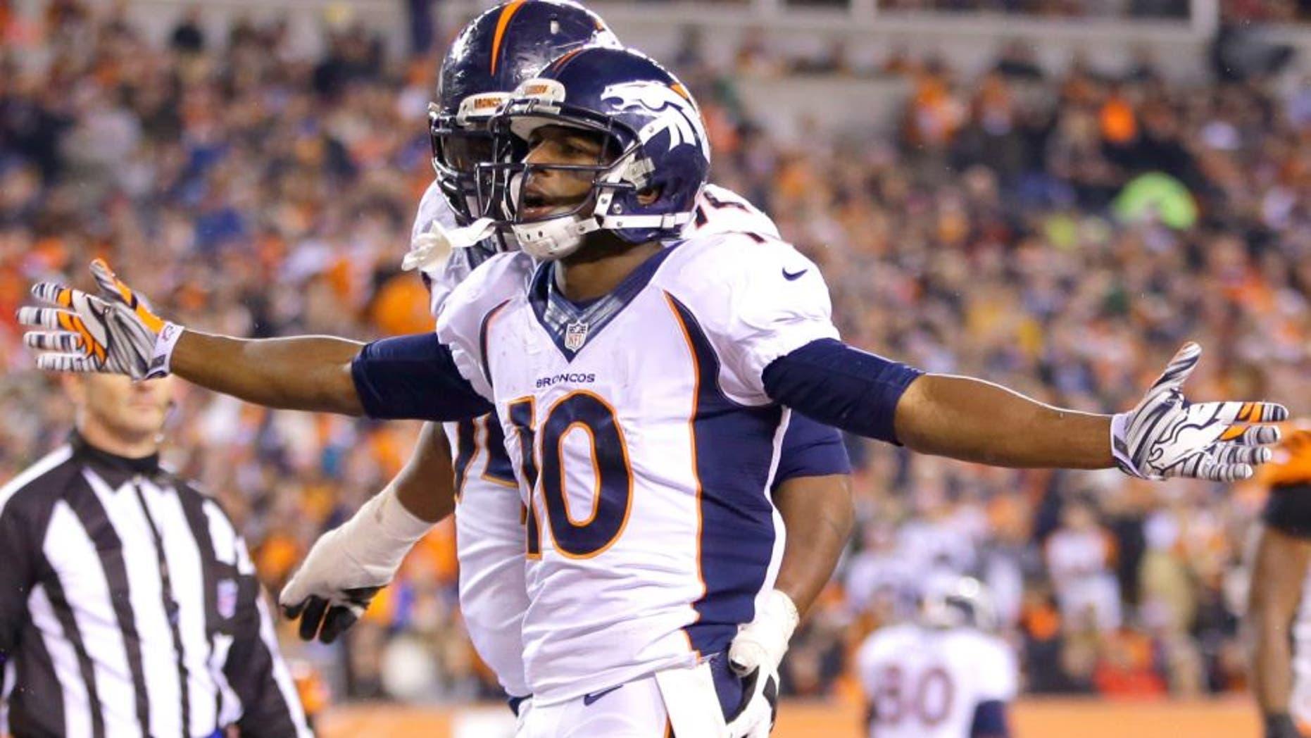 Denver Broncos wide receiver Emmanuel Sanders (10) reacts following a 4-yard touchdown reception during the second half of an NFL football game against the Cincinnati Bengals Monday, Dec. 22, 2014, in Cincinnati. (AP Photo/AJ Mast)