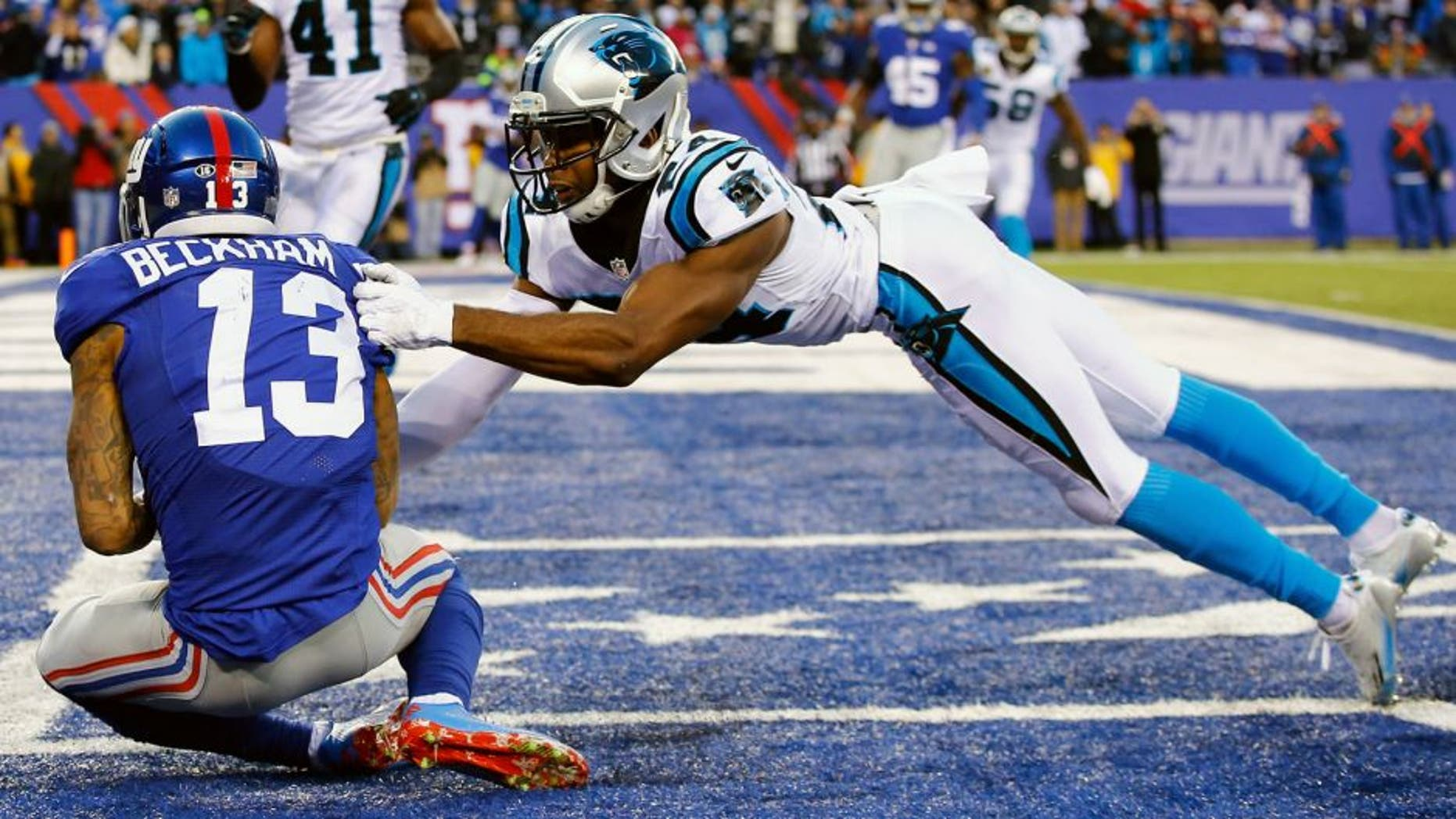 EAST RUTHERFORD, NJ - DECEMBER 20: Odell Beckham #13 of the New York Giants scores a game tying touchdown against Josh Norman #24 of the Carolina Panthers in the fourth Quarter during their game at MetLife Stadium on December 20, 2015 in East Rutherford, New Jersey. (Photo by Al Bello/Getty Images)