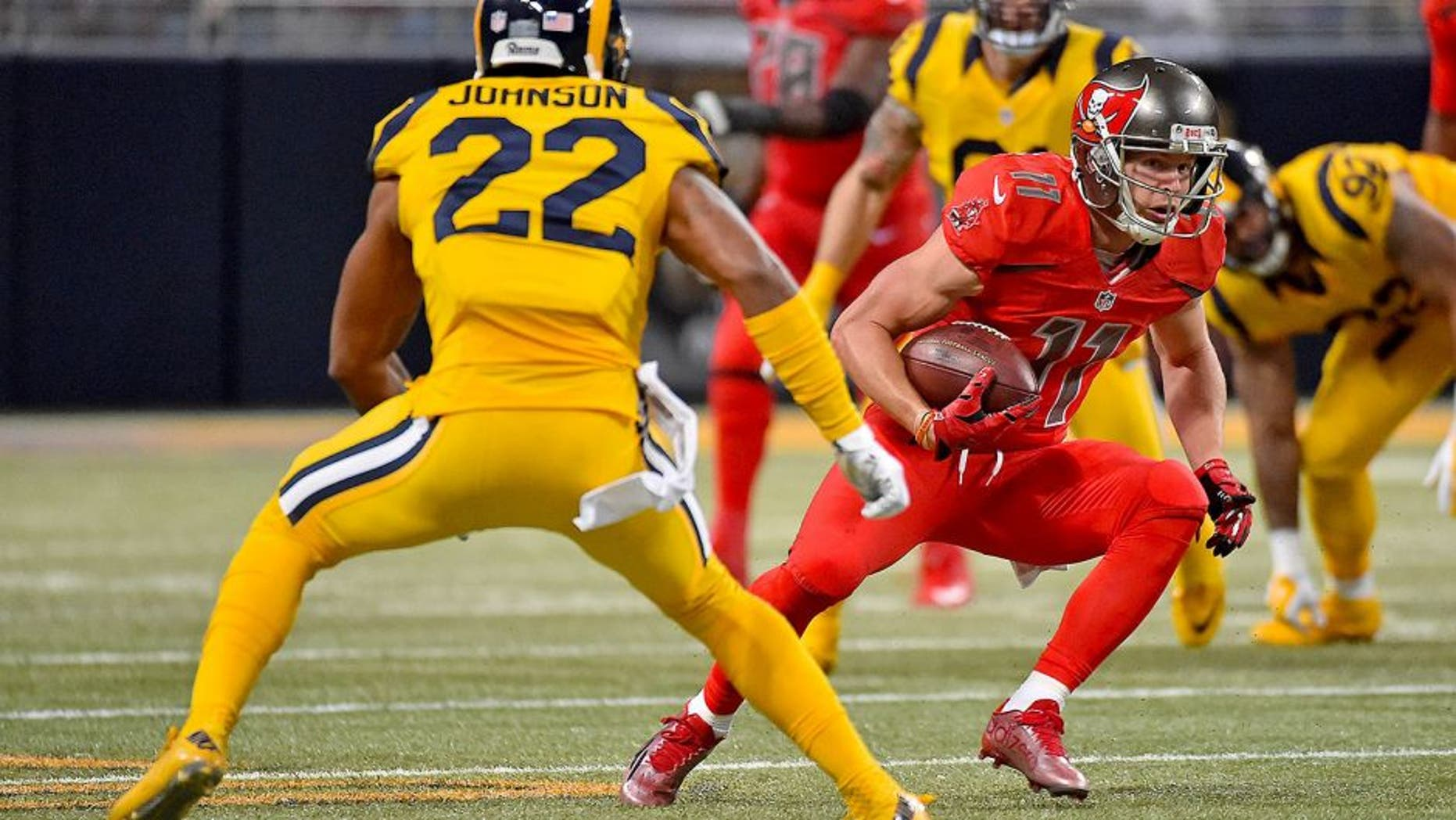 Dec 17, 2015; St. Louis, MO, USA; Tampa Bay Buccaneers wide receiver Adam Humphries (11) runs the ball against St. Louis Rams cornerback Trumaine Johnson (22) during the second half at the Edward Jones Dome. Mandatory Credit: Jasen Vinlove-USA TODAY Sports