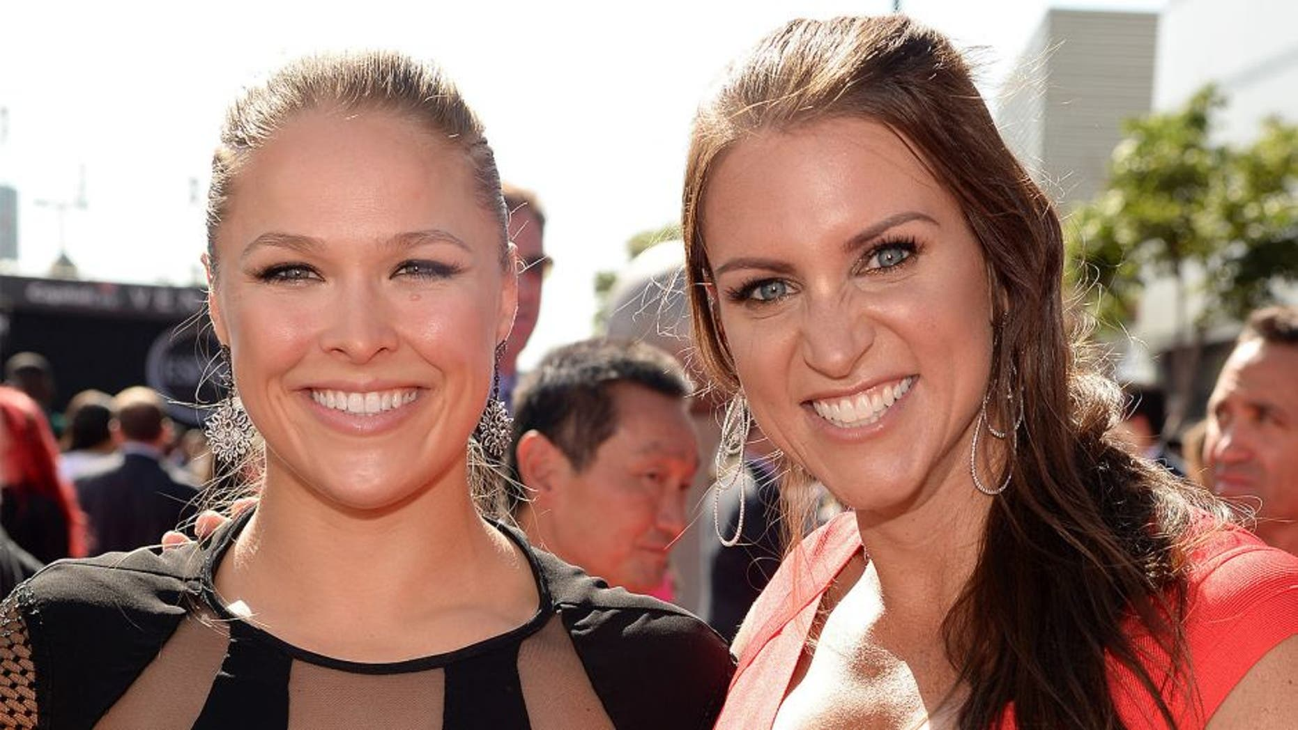LOS ANGELES, CA - JULY 15: UFC fighter Ronda Rousey (L) and Chief Brand Officer of WWE Stephanie McMahon attend The 2015 ESPYS at Microsoft Theater on July 15, 2015 in Los Angeles, California. (Photo by Kevin Mazur/WireImage)