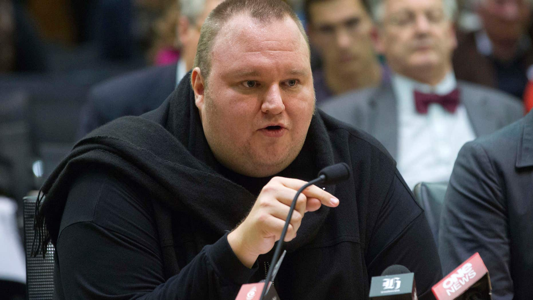 FILE - In this Wednesday, July 3, 2013 file photo, Internet entrepreneur Kim Dotcom speaks during the Intelligence and Security select committee hearing at Parliament in Wellington, New Zealand.