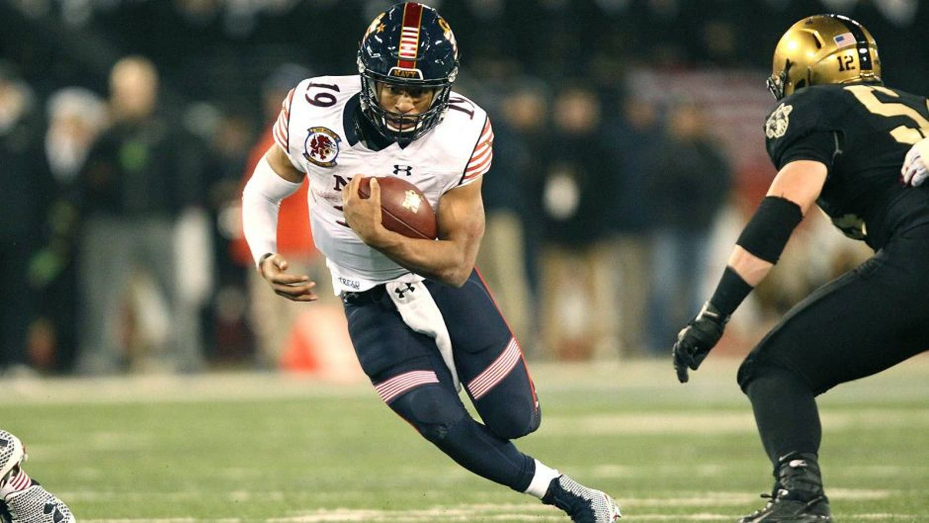 Dec 13, 2014; Baltimore, MD, USA; Navy Midshipmen quarterback Keenan Reynolds (19) rushes the ball against the Army Black Knights during the second half at M&T Bank Stadium. Mandatory Credit: Danny Wild-USA TODAY Sports