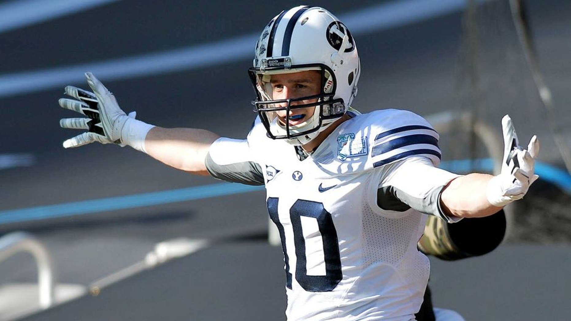 Dec 22, 2014; Miami, FL, USA; Brigham Young Cougars wide receiver Mitch Mathews (10) celebrates his touchdown against Memphis Tigers during the first quarter in the Miami Beach Bowl at Marlins Park. Mandatory Credit: Steve Mitchell-USA TODAY Sports