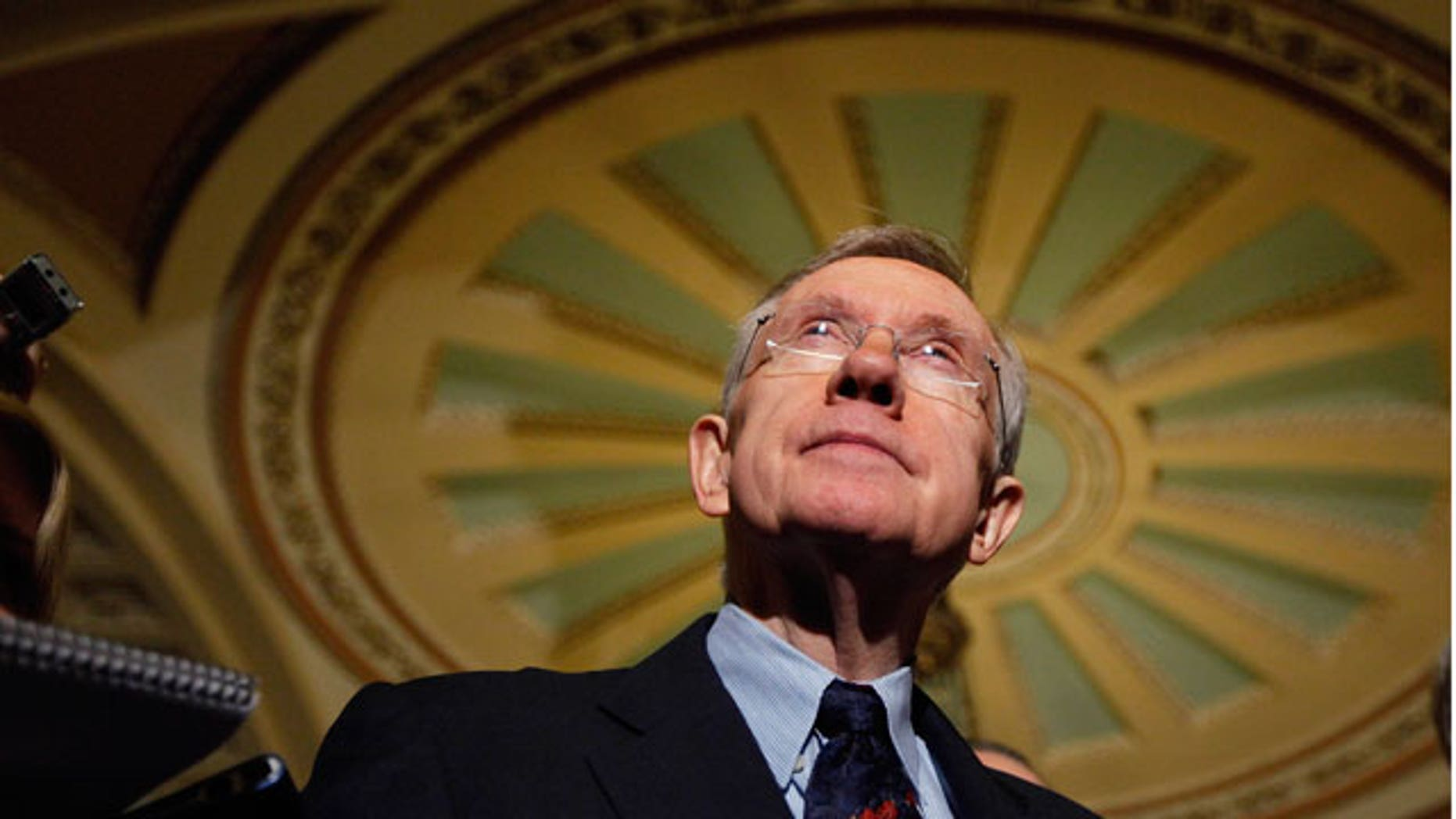 Dec. 24: Senate Majority Leader Harry Reid listens to questions following the passage of the Senate health care bill.