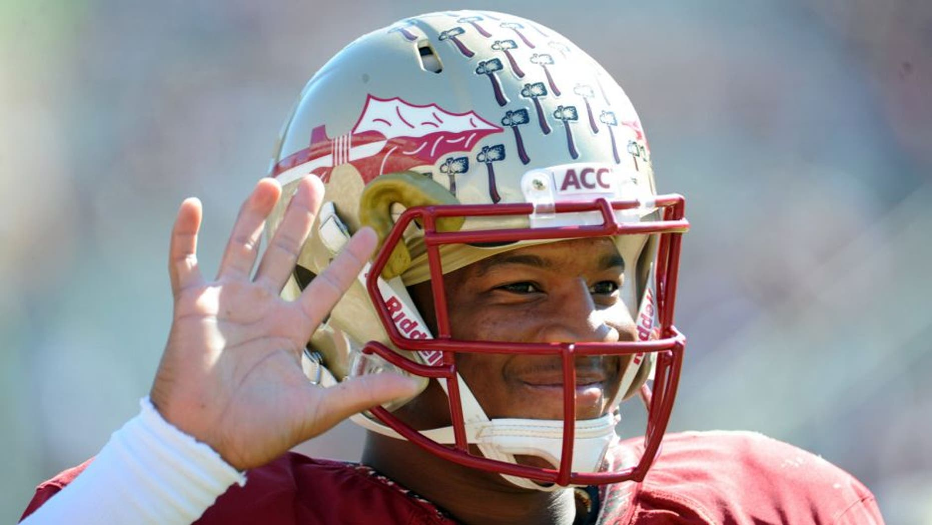 Oct 26, 2013; Tallahassee, FL, USA; Florida State Seminoles quarterback Jameis Winston (5) warms up before the start of the game against the North Carolina State Wolfpack at Doak Campbell Stadium. Mandatory Credit: Melina Vastola-USA TODAY Sports