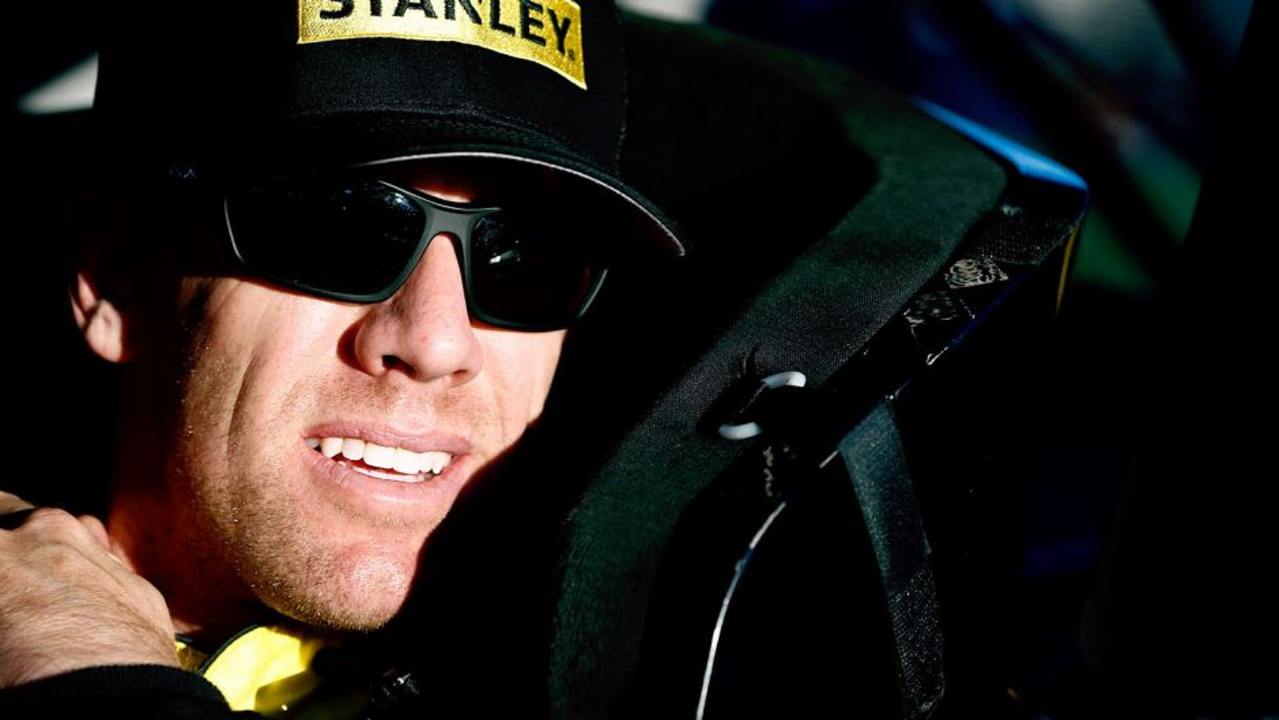 AVONDALE, AZ - NOVEMBER 13: Carl Edwards, driver of the #19 Stanley Toyota, sits in his car during qualifying for the NASCAR Sprint Cup Series Quicken Loans Race for Heroes 500 at Phoenix International Raceway on November 13, 2015 in Avondale, Arizona. (Photo by Jeff Zelevansky/NASCAR via Getty Images)