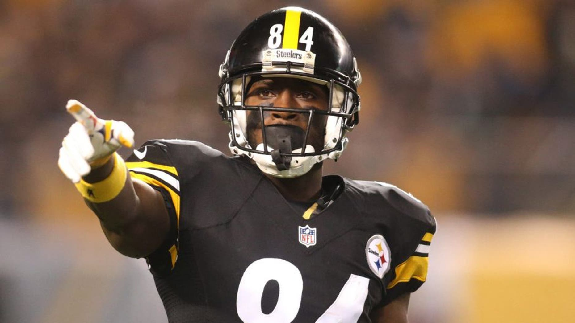 Dec 6, 2015; Pittsburgh, PA, USA; Pittsburgh Steelers wide receiver Antonio Brown (84) gestures at the line of scrimmage against the Indianapolis Colts during the second quarter at Heinz Field. Mandatory Credit: Charles LeClaire-USA TODAY Sports