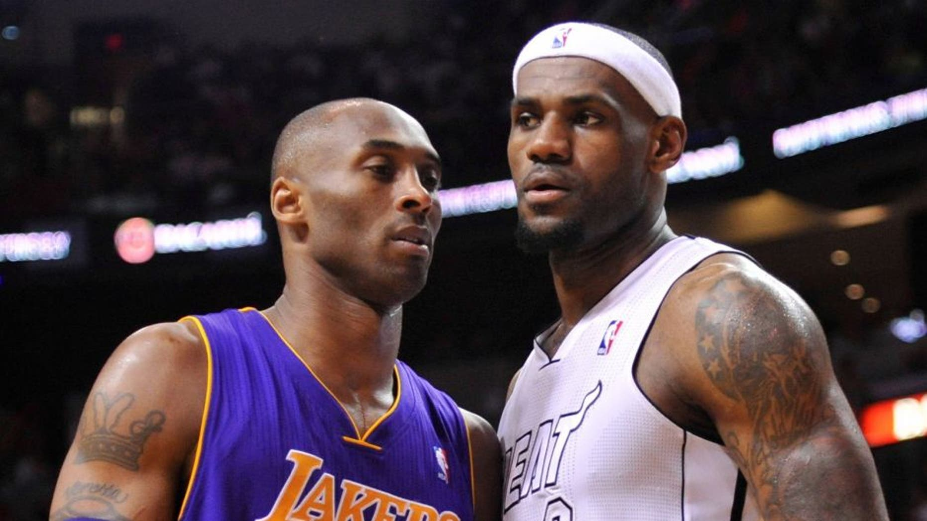 Feb 10, 2013; Miami, FL, USA; Los Angeles Lakers shooting guard Kobe Bryant (24) and Miami Heat small forward LeBron James (6) during the first half at American Airlines Arena. Mandatory Credit: Steve Mitchell-USA TODAY Sports