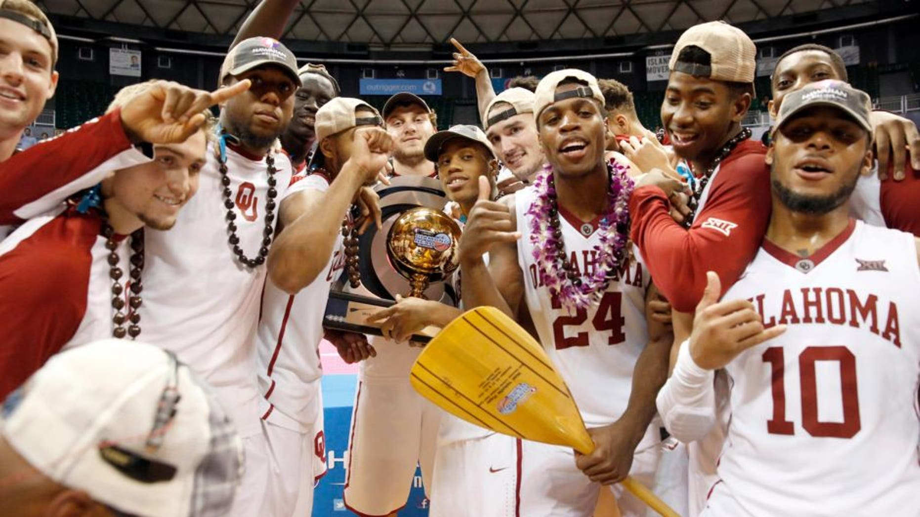 Dec 25, 2015; Honolulu, HI, USA; The Oklahoma Sooners celebrate after defeating the Harvard Crimson at the Stan Sheriff Center. Oklahoma Sooners defeated the Harvard Crimson 83-71. Mandatory Credit: Marco Garcia-USA TODAY Sports
