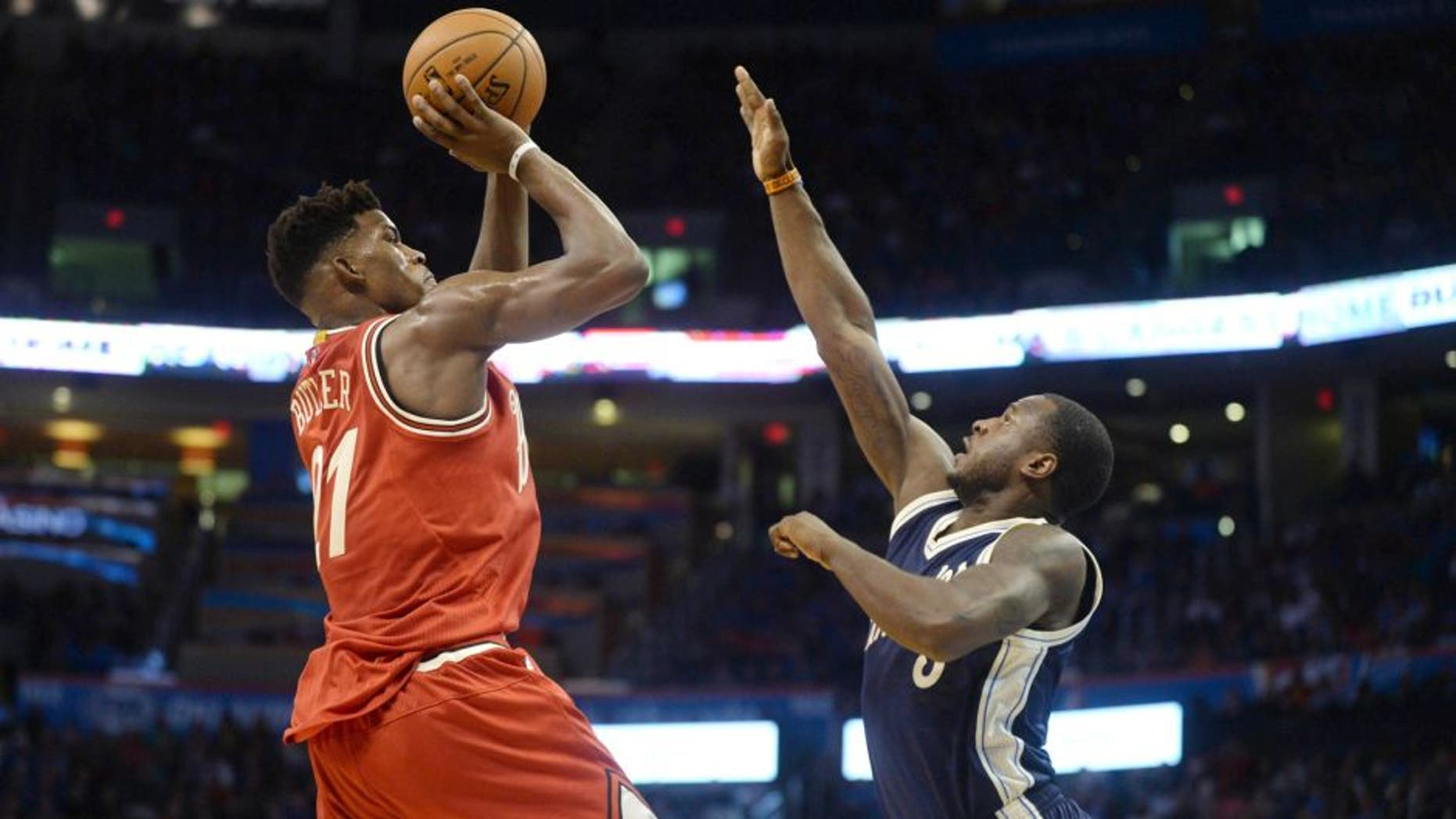 Dec 25, 2015; Oklahoma City, OK, USA; Chicago Bulls guard Jimmy Butler (21) shoots the ball against Oklahoma City Thunder guard Dion Waiters (3) during the second half of a NBA basketball game on Christmas at Chesapeake Energy Arena. Mandatory Credit: Mark D. Smith-USA TODAY Sports