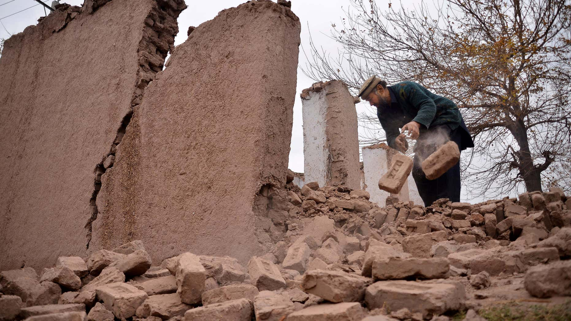 Dec. 26, 2015: An Afghan villager removes bricks after his home was damaged from an earthquake in Surkhroad district of Jalalabad east of Kabul, Afghanistan.