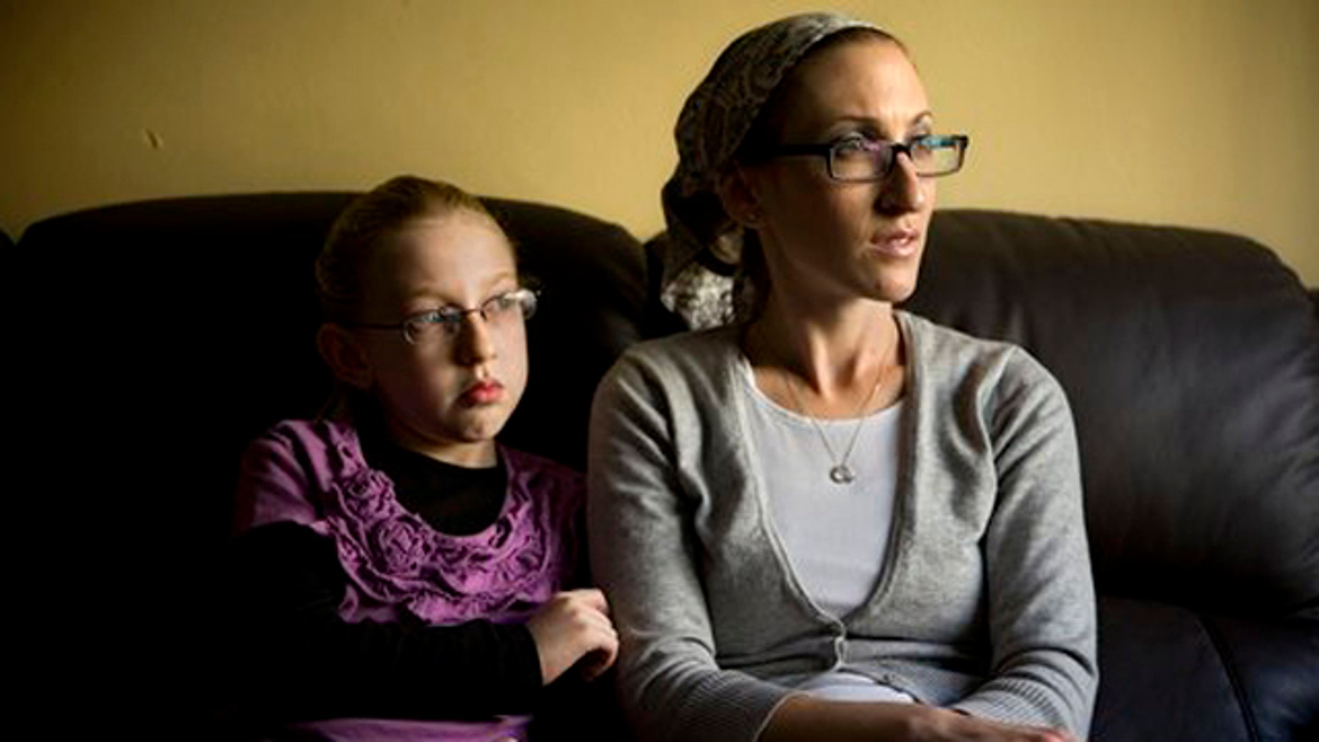 December 26, 2011: Naama Margolese, 8, sits with her mother Hadassa in their home in the central Israeli town of Beit Shemesh.