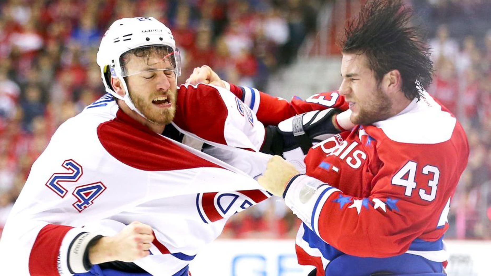 WASHINGTON, DC - DECEMBER 26: Jarred Tinordi #24 of the Montreal Canadiens and Tom Wilson #43 of the Washington Capitals exchange punches during the first period at Verizon Center on December 26, 2015 in Washington, DC. (Photo by Maddie Meyer/Getty Images)