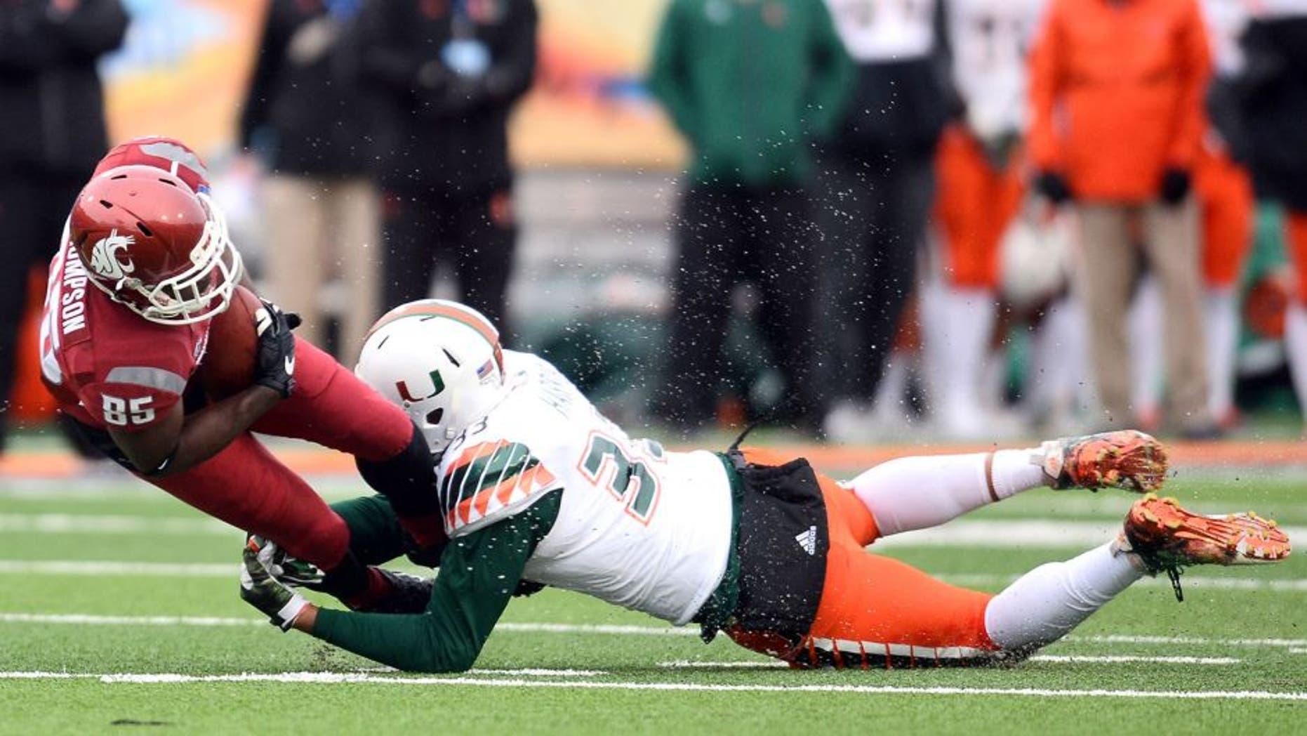 Dec 26, 2015; El Paso, TX, USA; Miami Hurricanes defensive lineman Trent Harris (33) tackles Washington State Cougars wide receiver John Thompson (85) during the second half at Sun Bowl Stadium. Mandatory Credit: Joe Camporeale-USA TODAY Sports