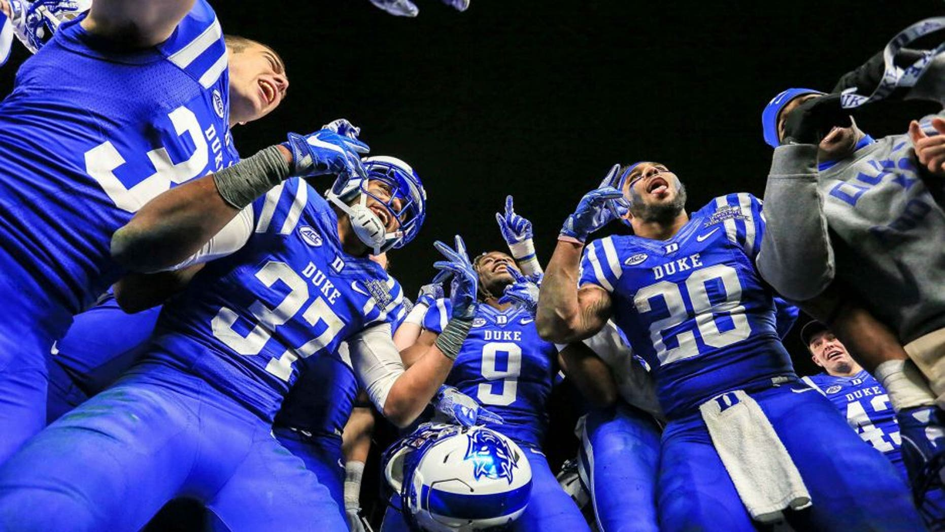 Dec 26, 2015; Bronx, NY, USA; The Duke Blue Devils players celebrate after their 2015 New Era Pinstripe Bowl against the Indiana Hoosiers at Yankee Stadium. The Blue Devils won 44-41 in overtime. Mandatory Credit: Vincent Carchietta-USA TODAY Sports