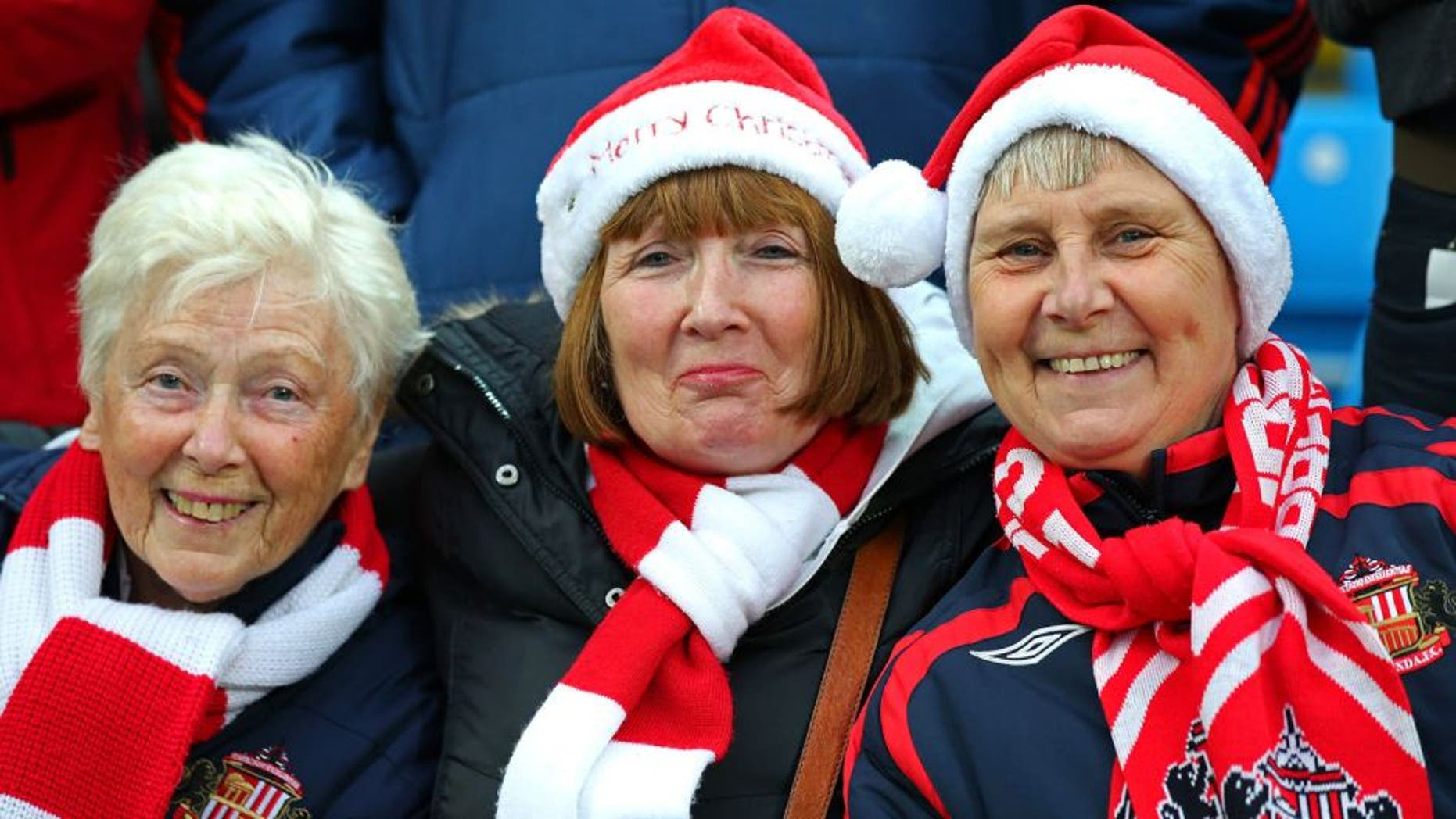 MANCHESTER, ENGLAND - DECEMBER 26: Sunderland fans enjoy the atmosphere during the Barclays Premier League match between Manchester City and Sunderland at the Etihad Stadium on December 26, 2015 in Manchester, England. (Photo by Alex Livesey/Getty Images)